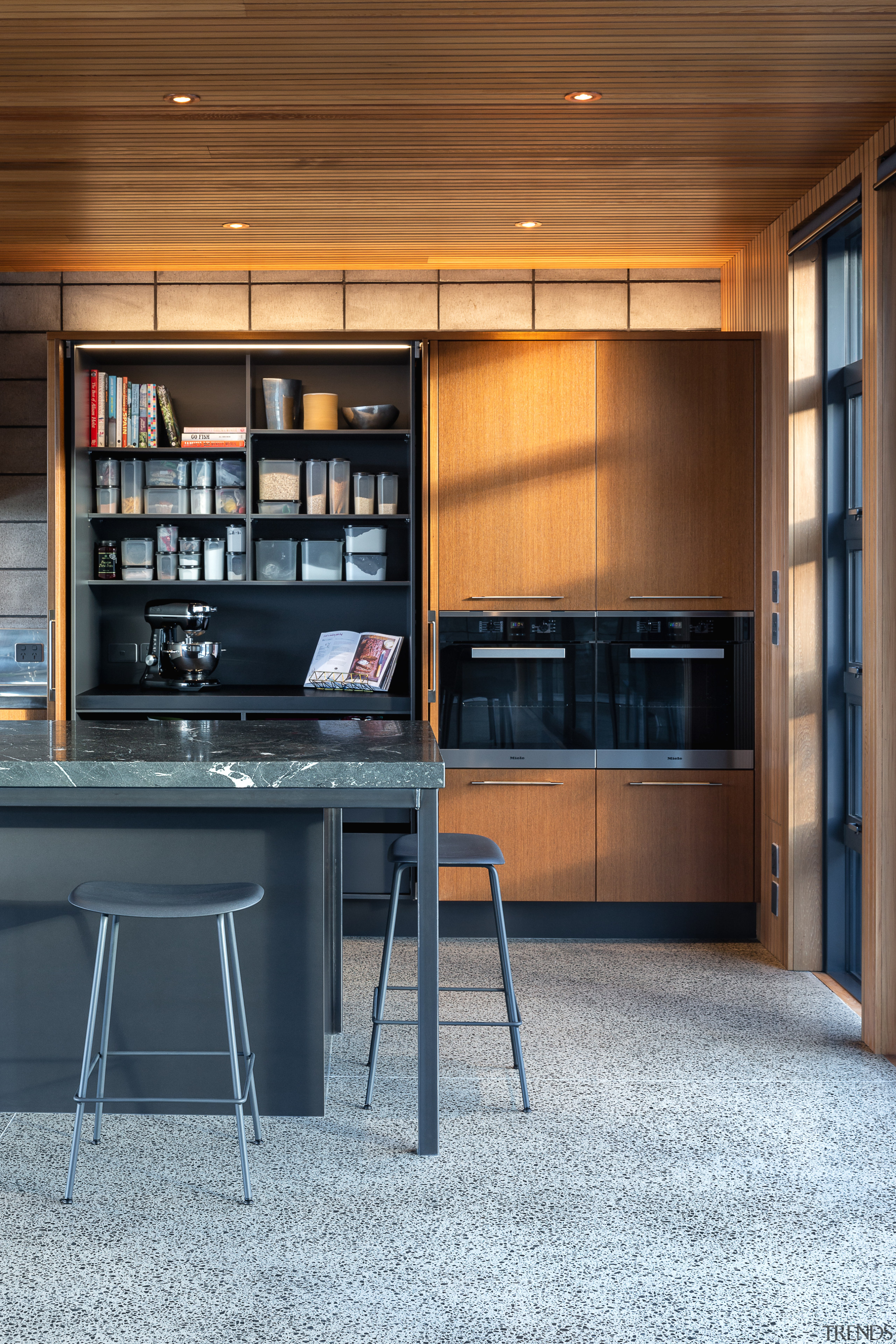 When your passion is baking it makes sense architecture, building, cabinetry, ceiling, countertop, cupboard, floor, flooring, furniture, home, house, interior design, kitchen, plywood, property, room, shelf, shelving, table, wood, brown