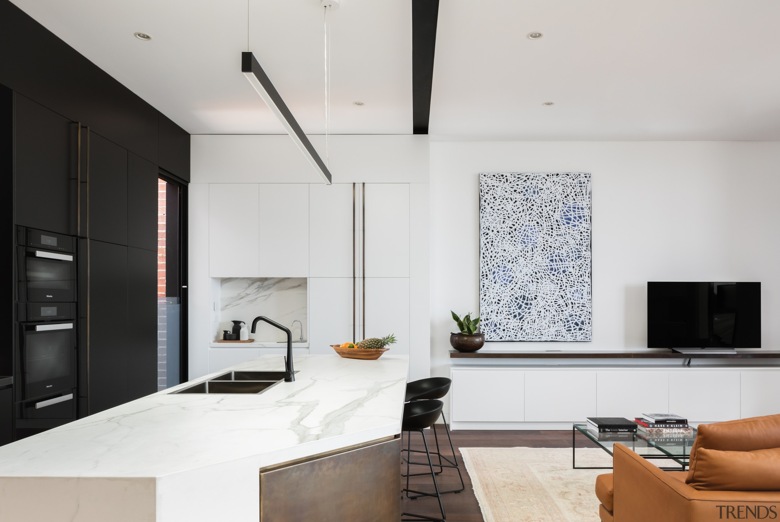 ​​​​​​​A bronze, white and black palette in this interior design, kitchen, living room, benchtop, CDK Stone, Biji Architects