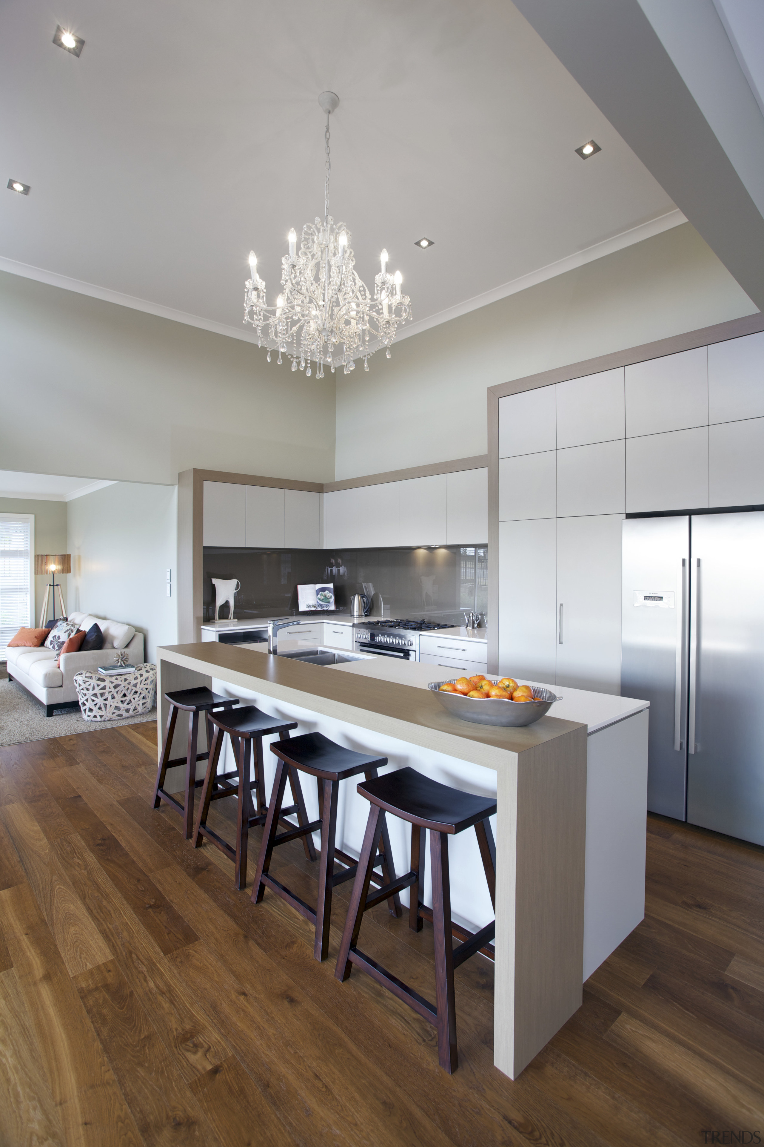 this airy residence is by Fowler Homes - ceiling, countertop, dining room, floor, flooring, hardwood, interior design, kitchen, room, table, wood flooring, gray, brown
