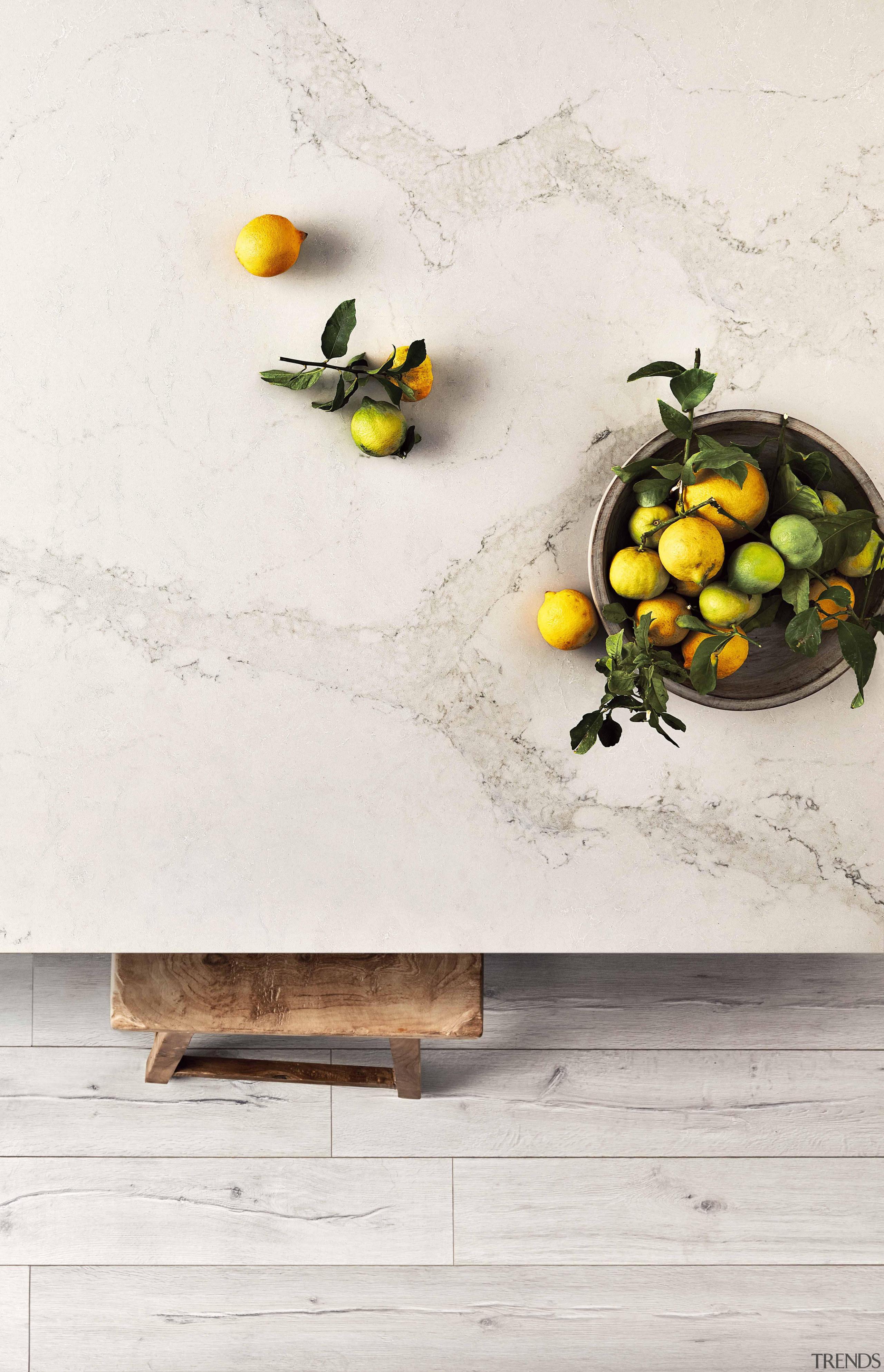 As Caesarstone's interpretation of natural Calacatta marble, Calacatta fruit, produce, still life photography, table, yellow, white