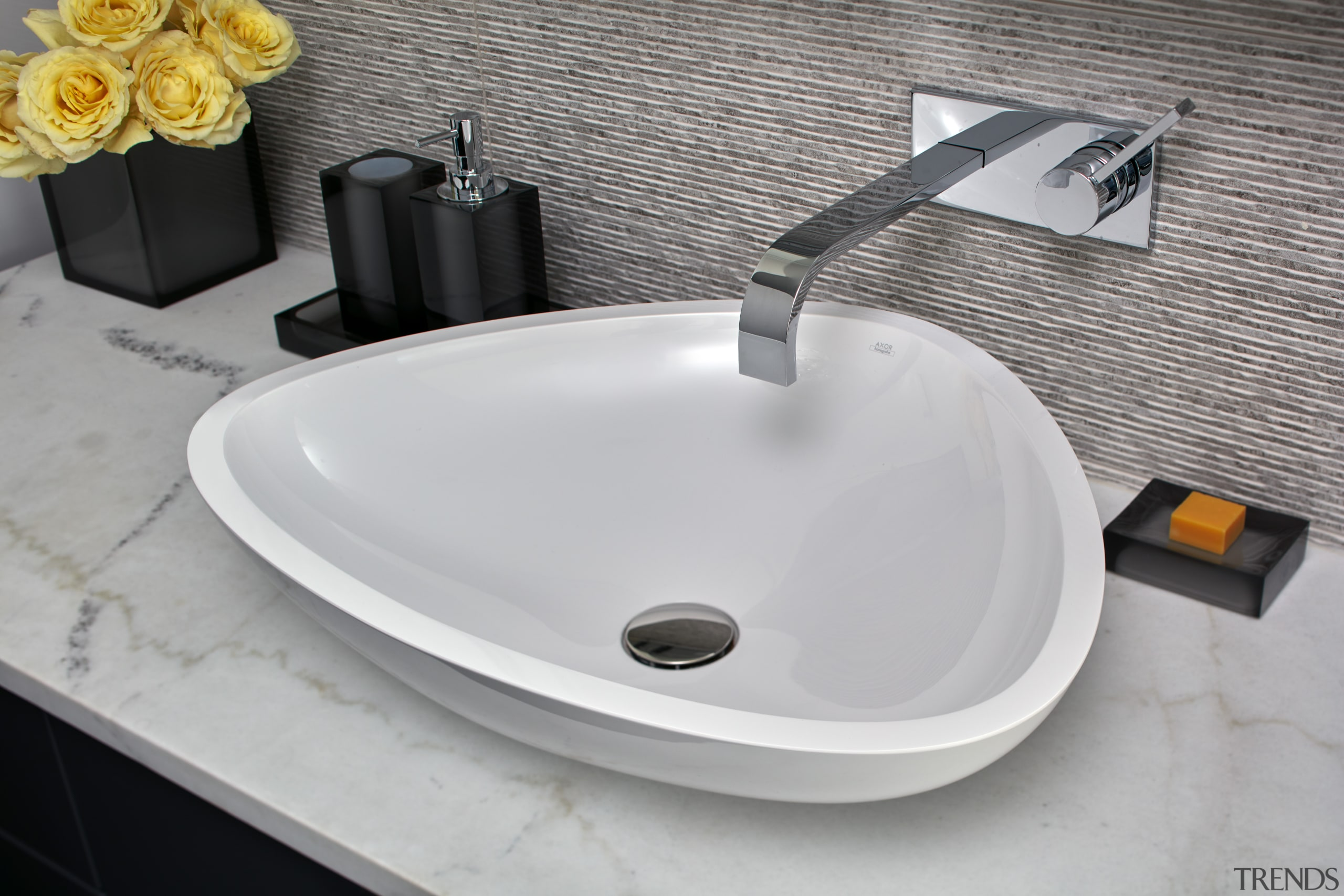 Soft-curve triangular basins are complemented by veined marble bathroom sink, ceramic, plumbing fixture, product, sink, tap, gray