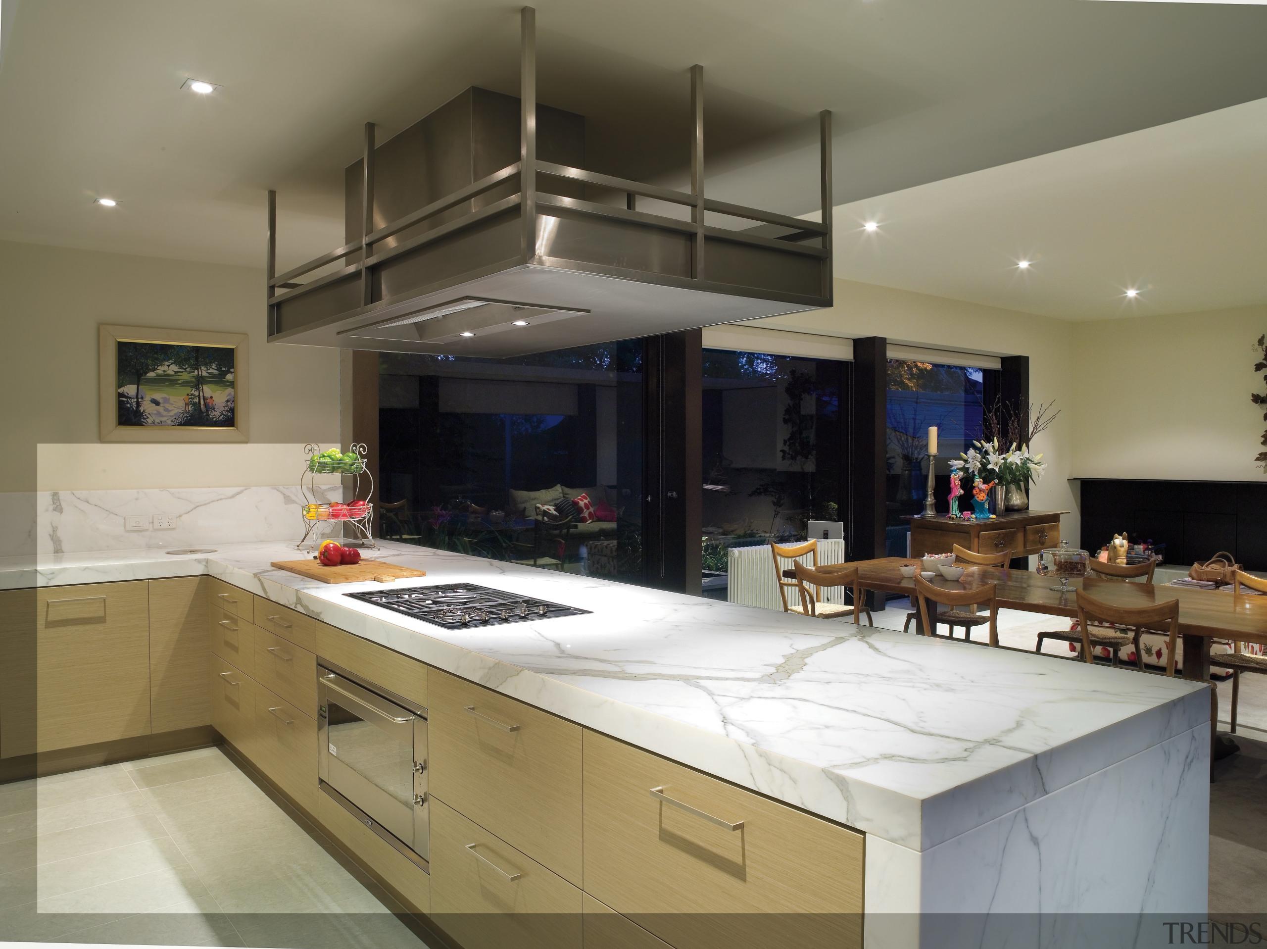 A view of this kitchen featuring clalcutta marble countertop, cuisine classique, interior design, kitchen, real estate, gray
