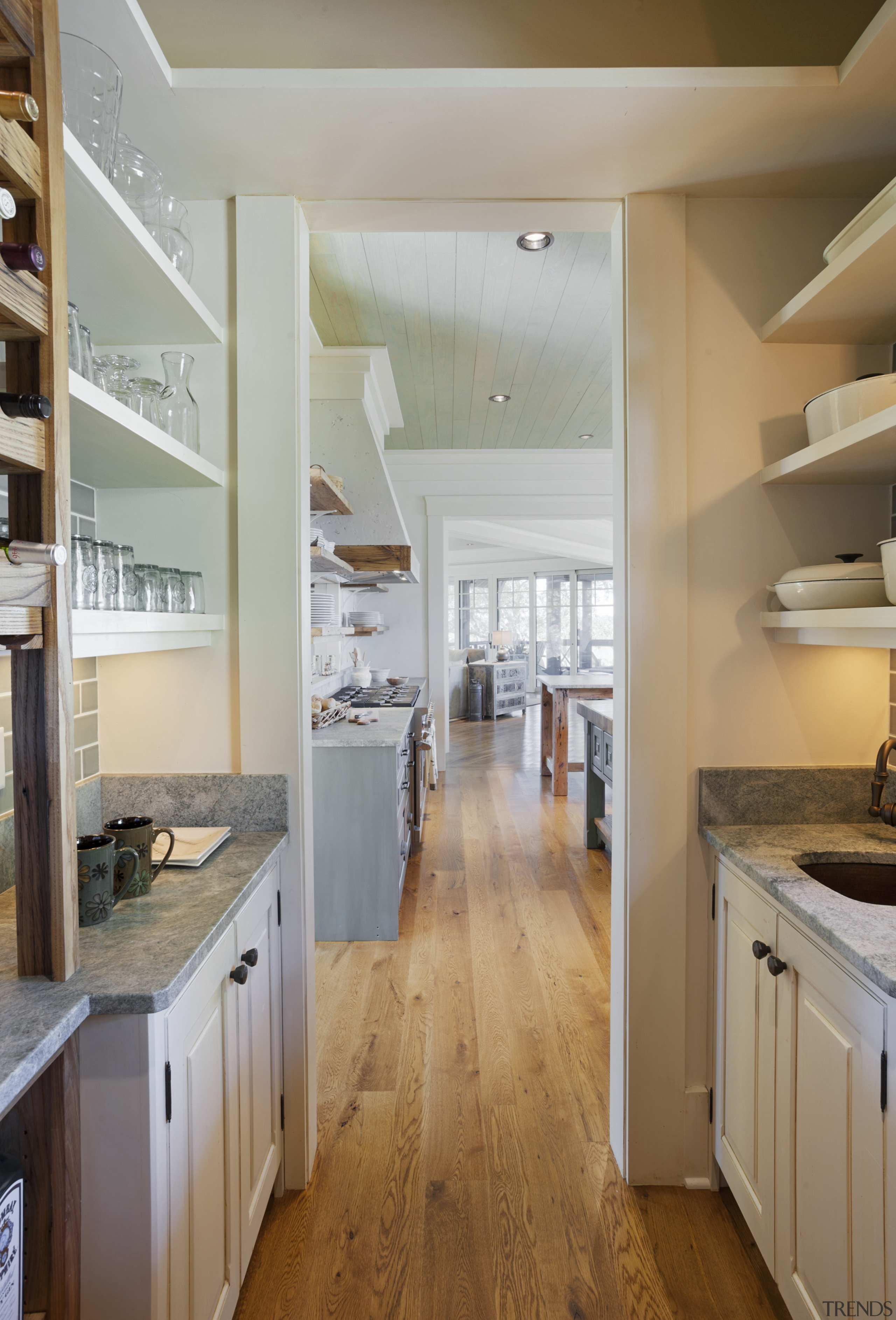 This large scullery provides penty of storage. The cabinetry, ceiling, countertop, cuisine classique, floor, flooring, hardwood, home, interior design, kitchen, real estate, room, wood flooring, gray, brown