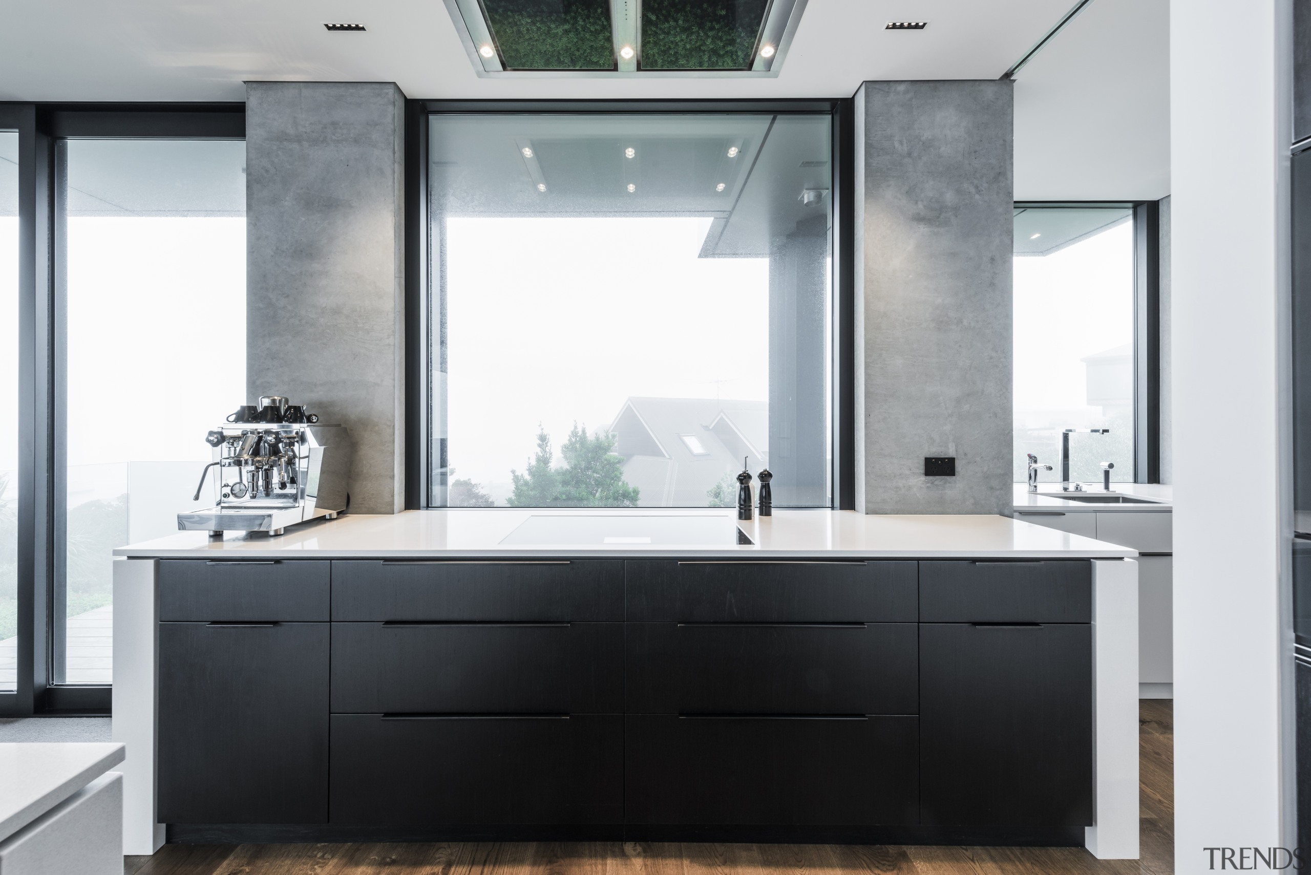 ​​​​​​​Positioned to the side of this kitchen, the bathroom, bathroom accessory, bathroom cabinet, countertop, interior design, kitchen, sink, gray, black, white