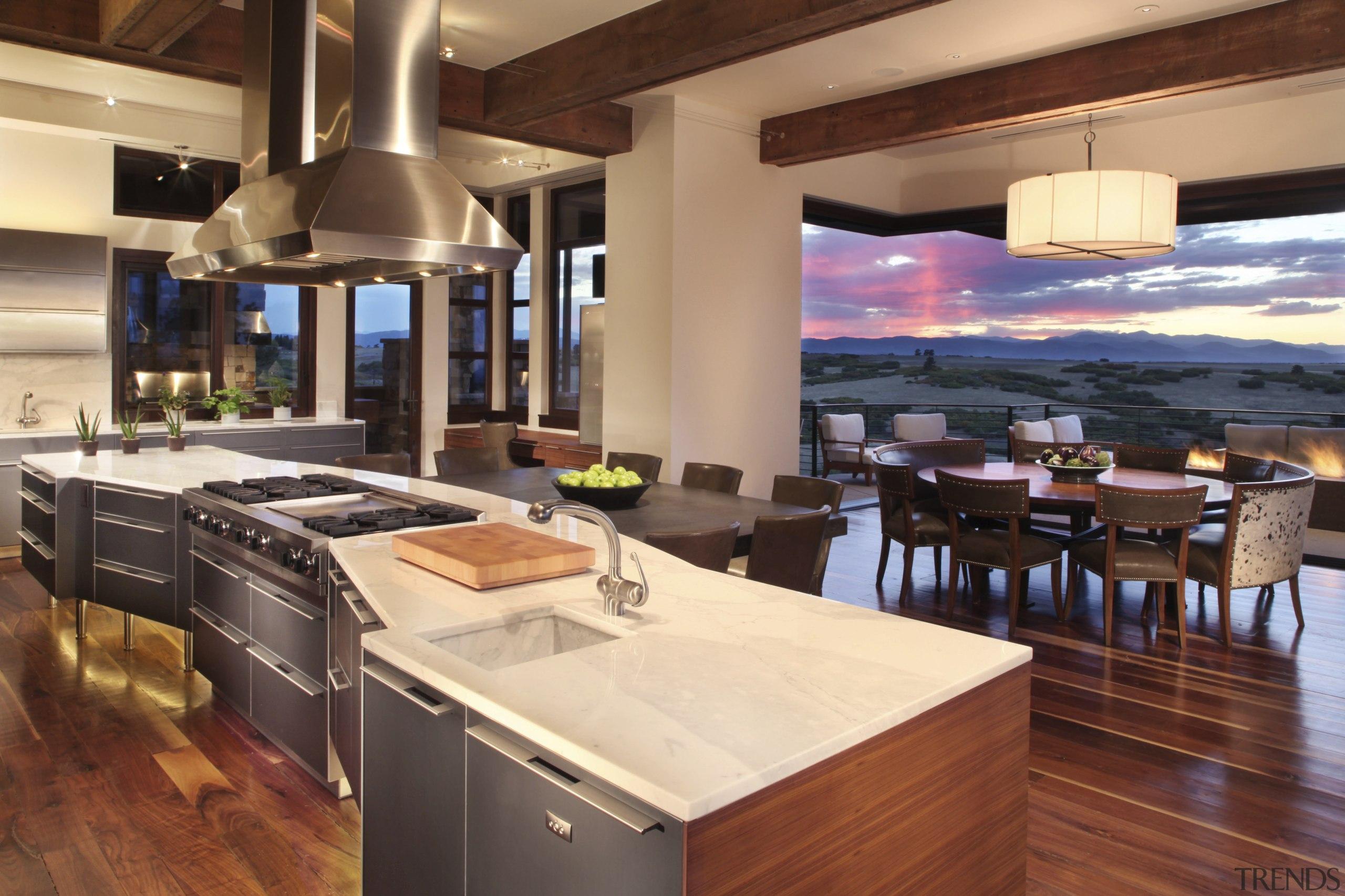 This kitchen was designed and manufactured by Bulthaup. countertop, interior design, kitchen, orange