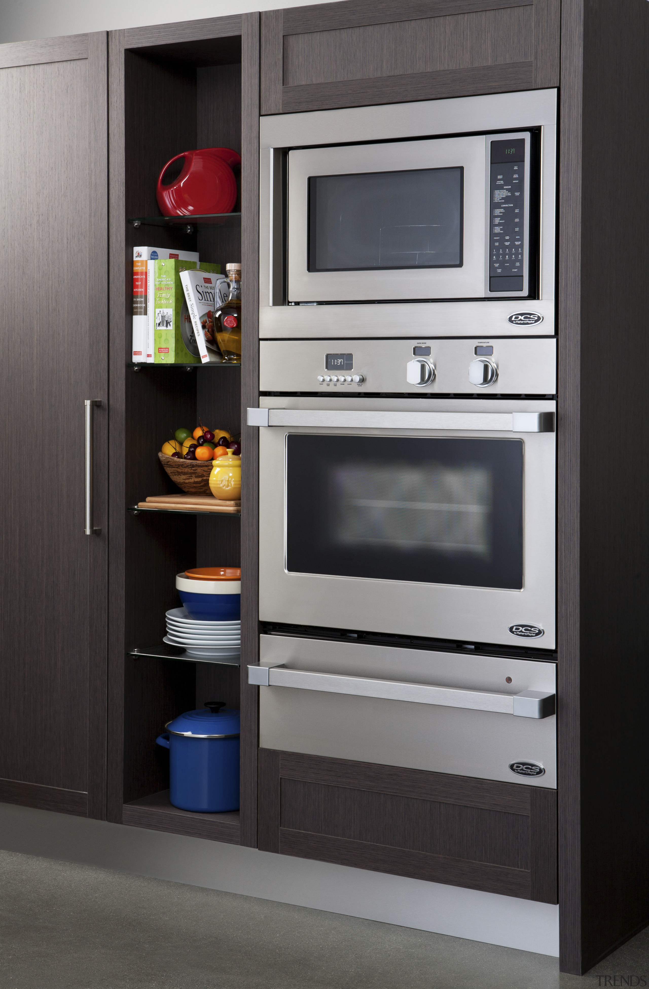 View of the new indoor kitchen collection by furniture, home appliance, kitchen, kitchen appliance, kitchen stove, major appliance, microwave oven, oven, refrigerator, gray, black