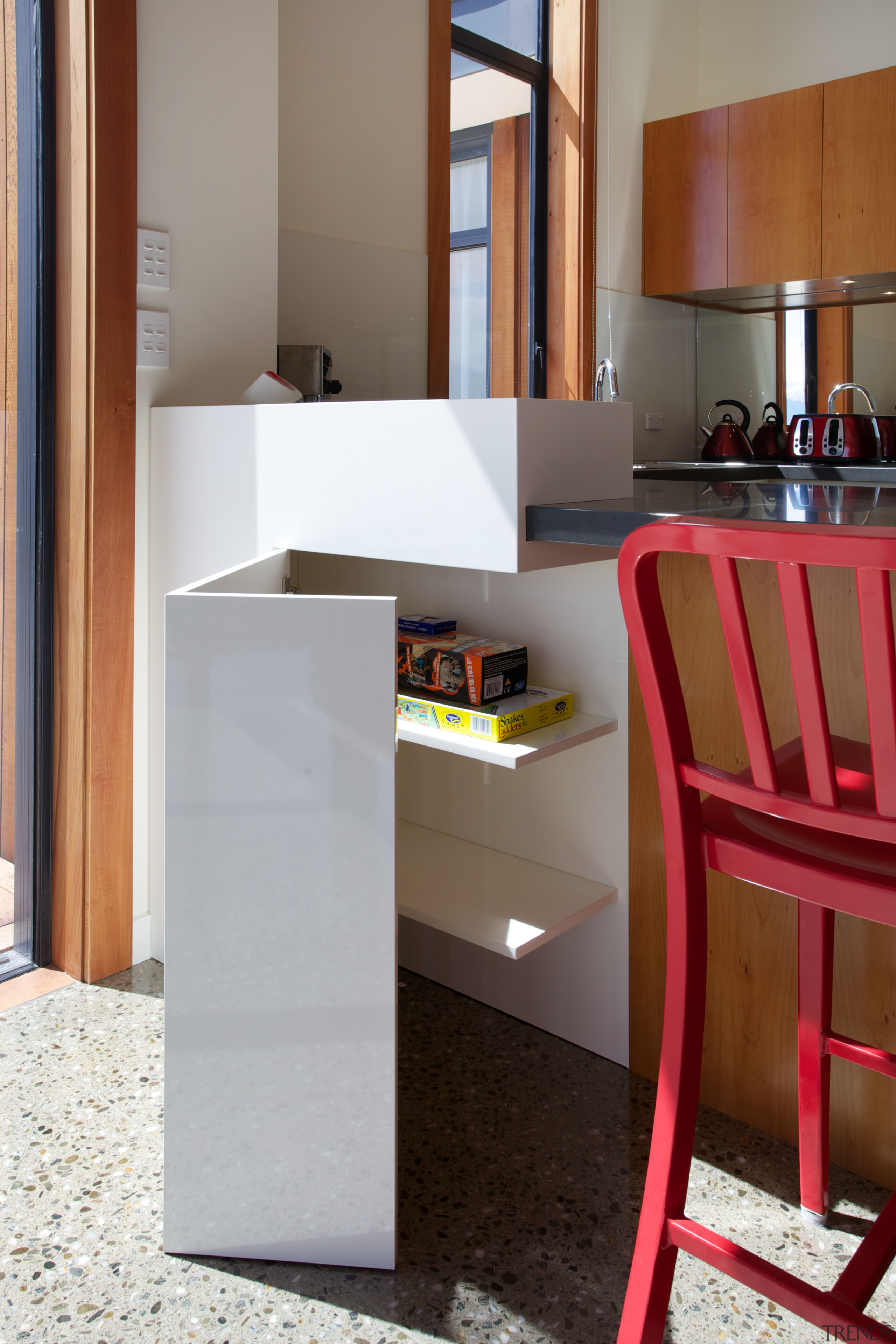This side cabinet in a kitchen in a floor, flooring, furniture, interior design, product design, shelf, shelving, table, gray