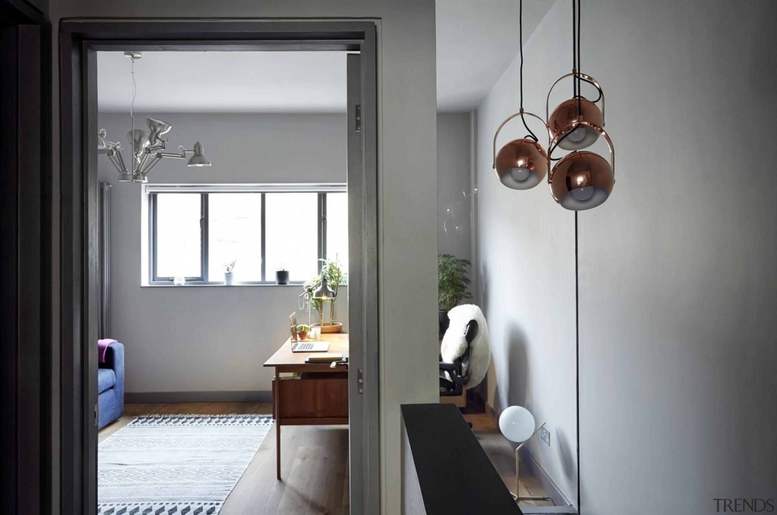 A wider view of the hallway - A home, house, interior design, light fixture, lighting, room, window, gray