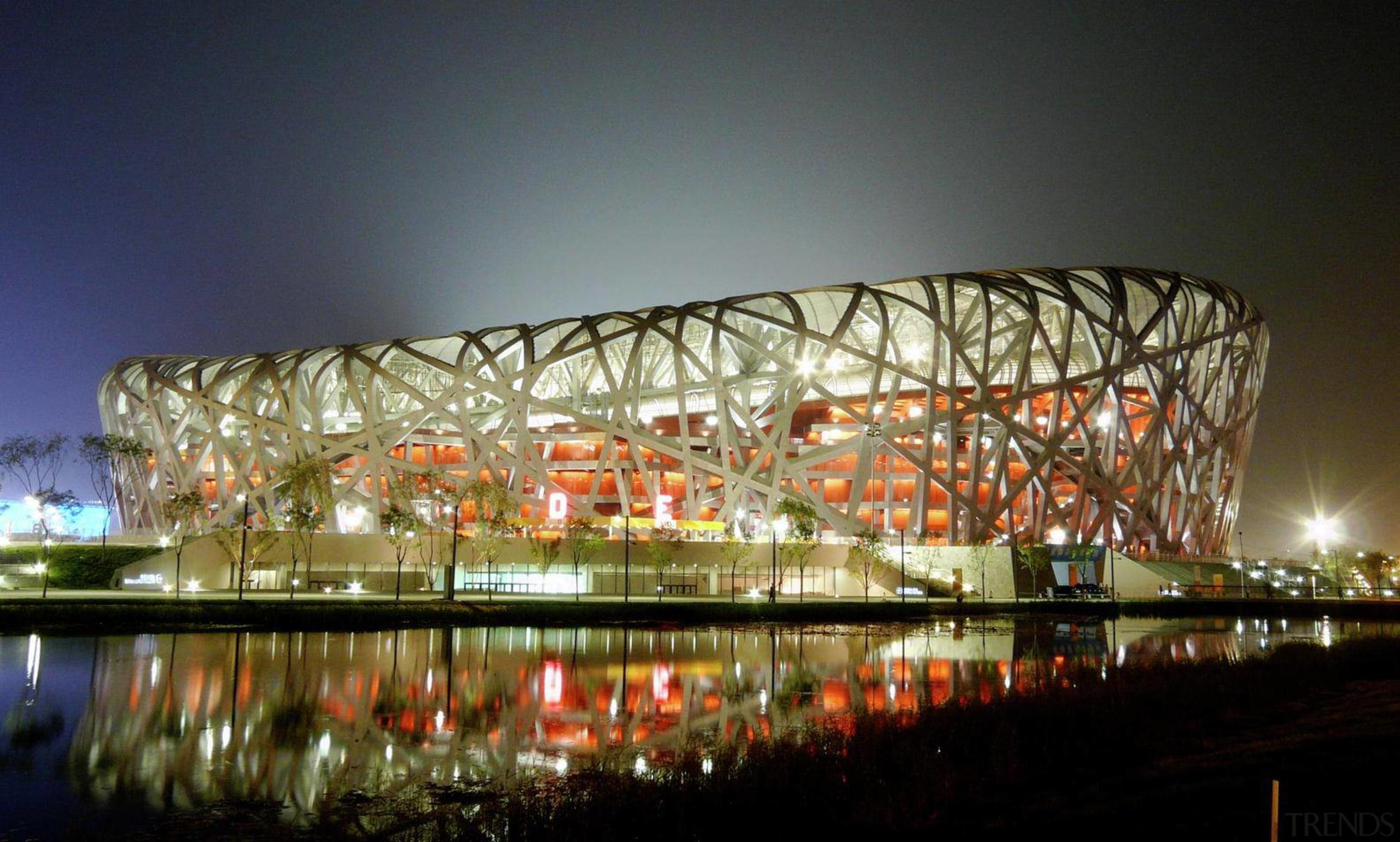 Beijing National Stadium by Herzog de Meuron, ArupSport architecture, convention center, lighting, mixed use, night, opera house, reflection, sport venue, stadium, structure, brown, black