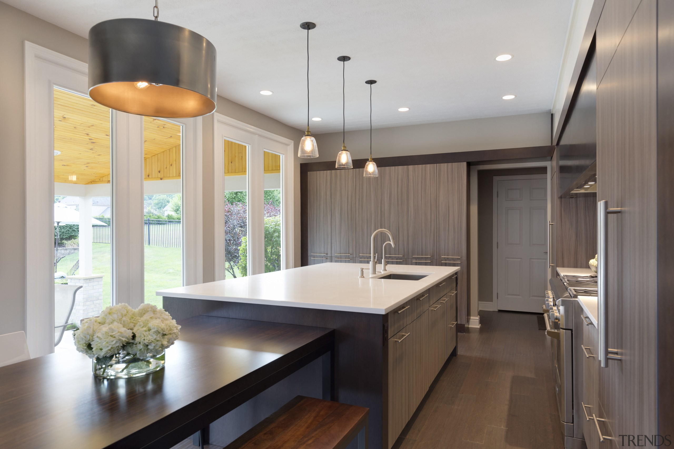A large island and two walls of cabinetry cabinetry, ceiling, countertop, cuisine classique, interior design, kitchen, real estate, room, gray