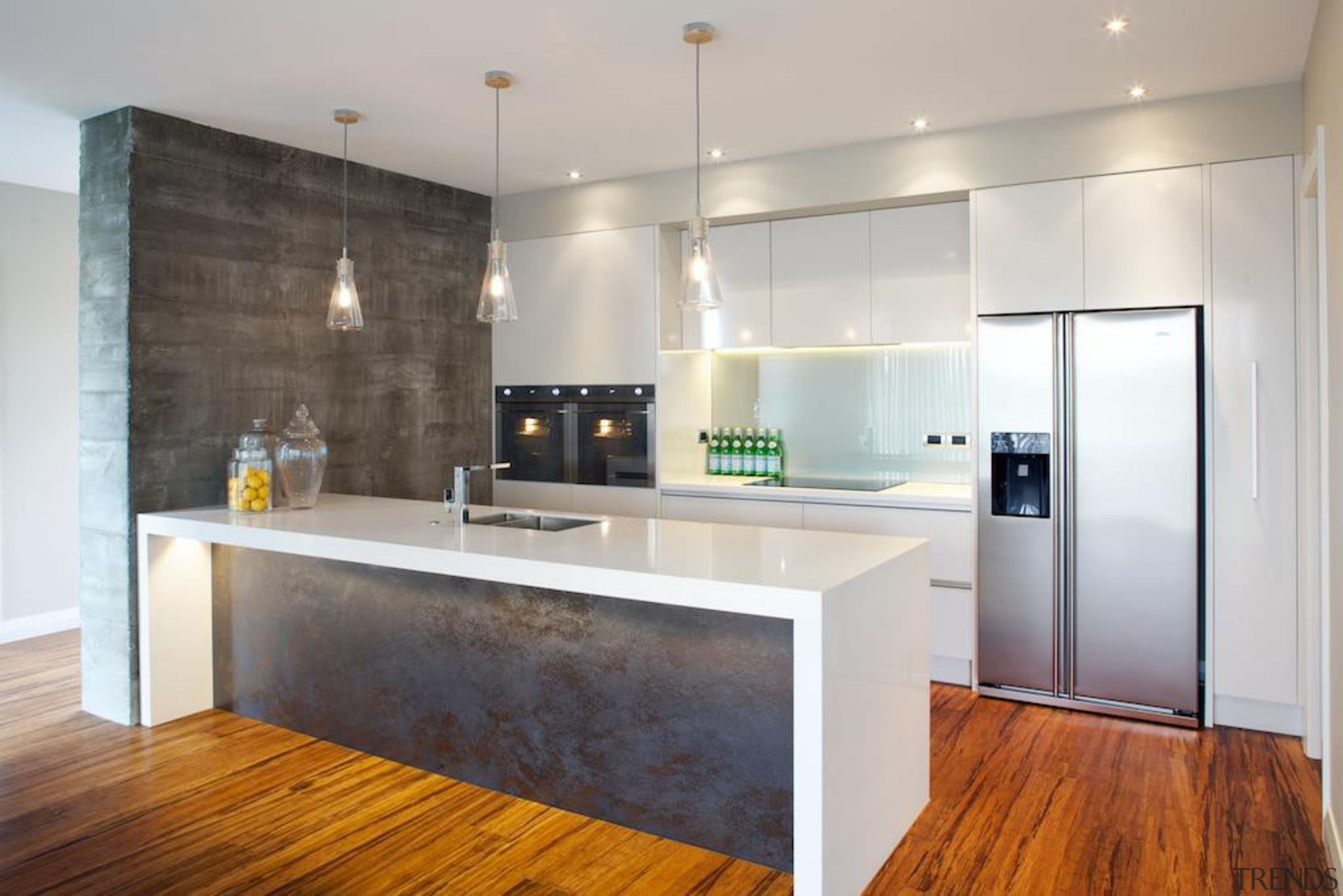 This industrial style kitchen makes use of a cabinetry, countertop, floor, flooring, interior design, kitchen, real estate, room, wood flooring, gray
