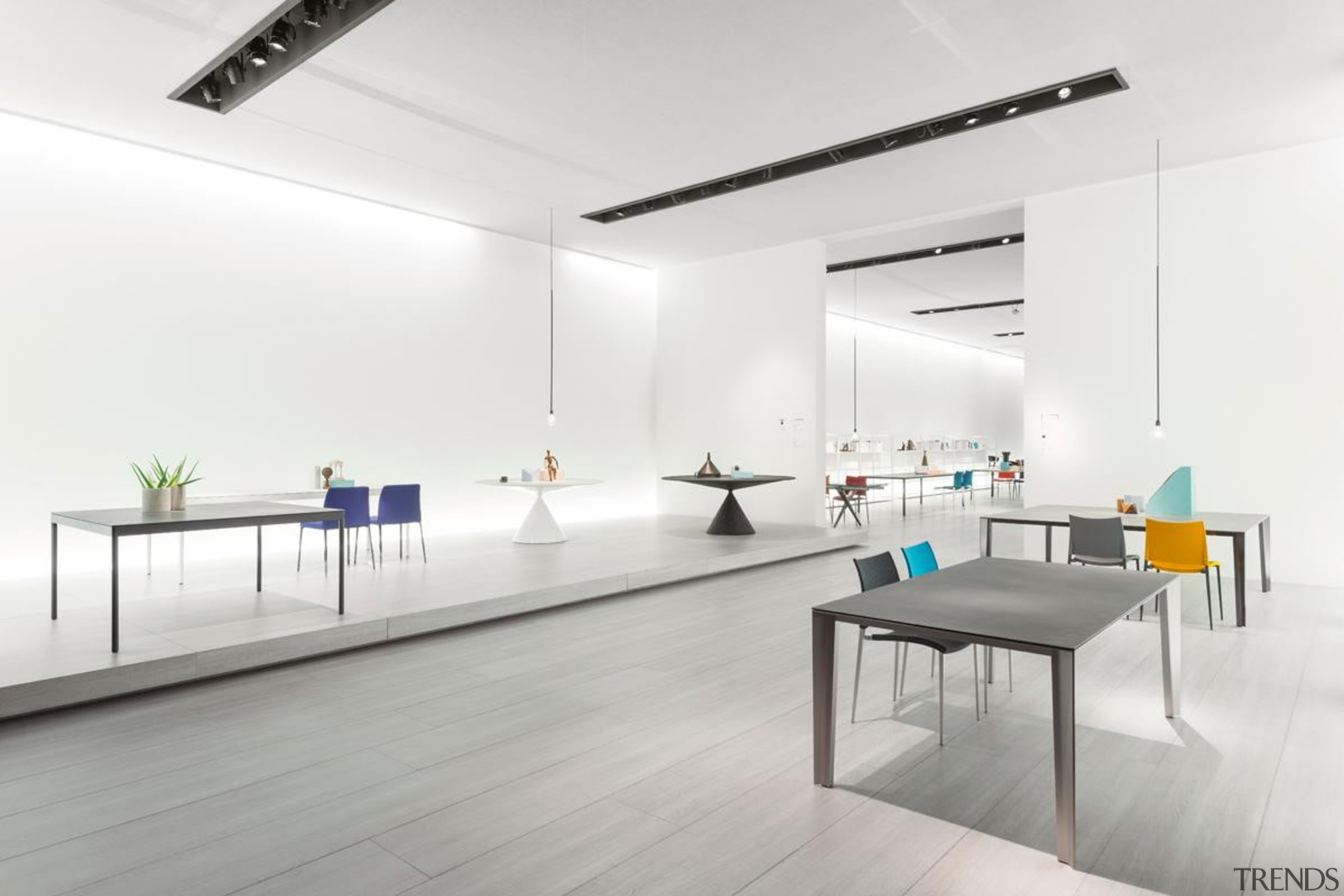 This year's International Furniture Fair Milan, featured many architecture, floor, furniture, interior design, office, table, white