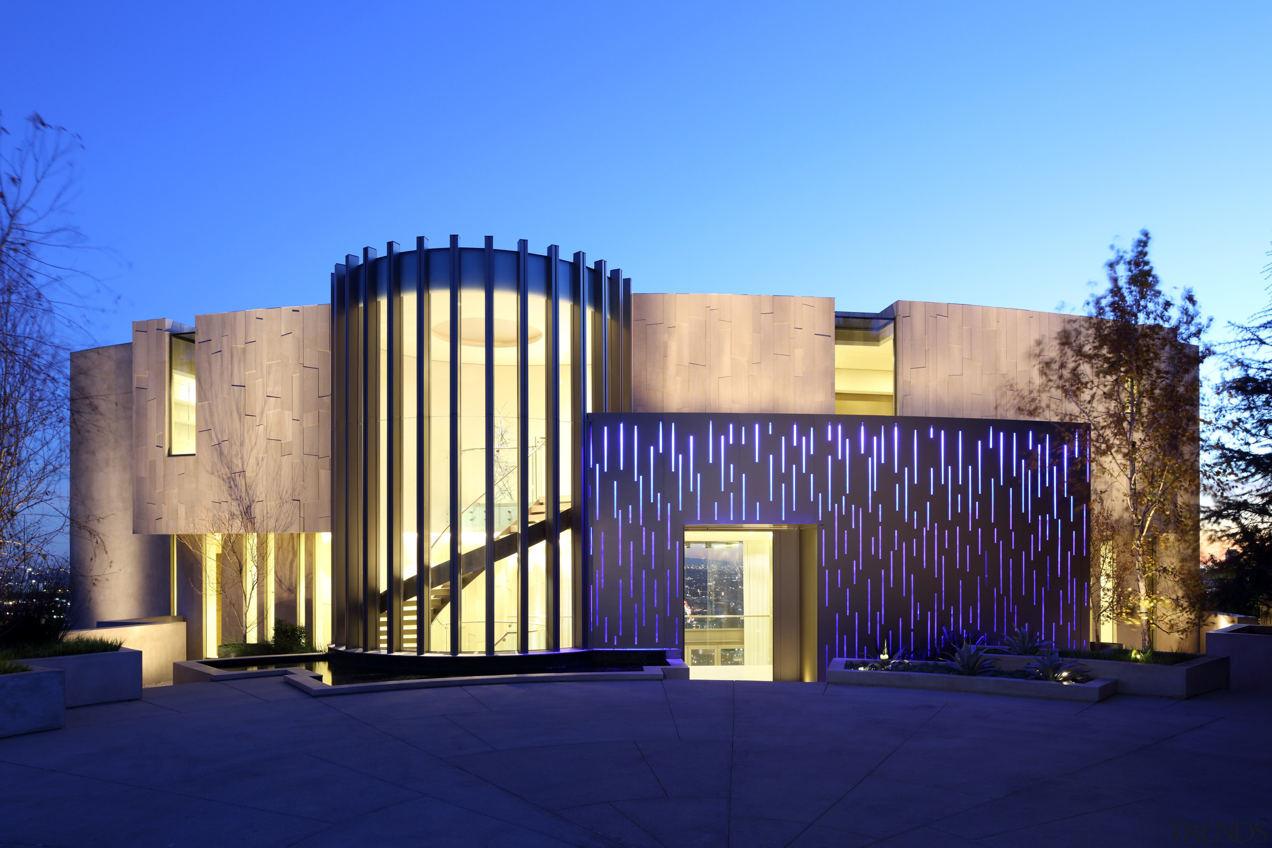 Dramatic entrance  a gently curving wall of architecture, building, corporate headquarters, estate, facade, home, house, lighting, property, real estate, tourist attraction, blue