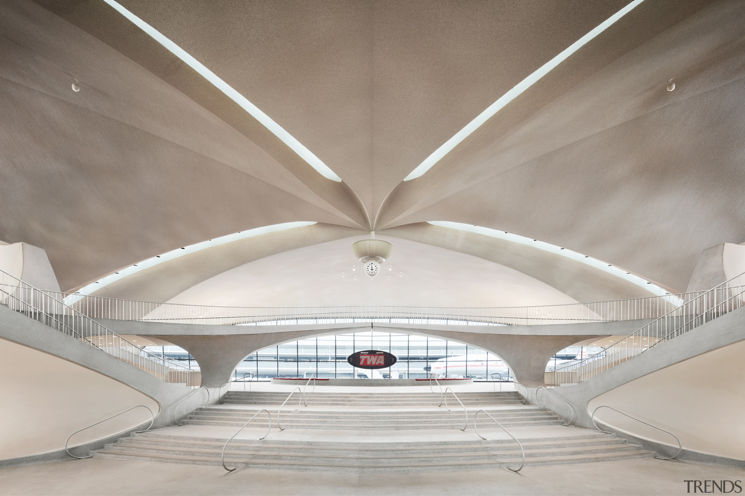 A view toward The Sunken Lounge and the architecture, building, Sunken Lounge,  TWA Hotel,  1958 Lockhead Constellation, Terminal Entrance