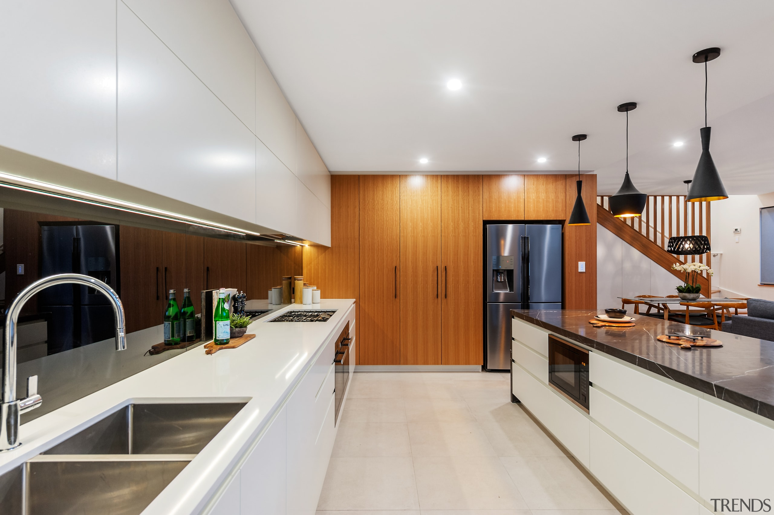 The kitchen is in centre of house relative apartment, architecture, building, cabinetry, ceiling, countertop, design, floor, flooring, furniture, hardwood, home, house, interior design, kitchen, loft, property, real estate, room, wood, wood flooring, gray