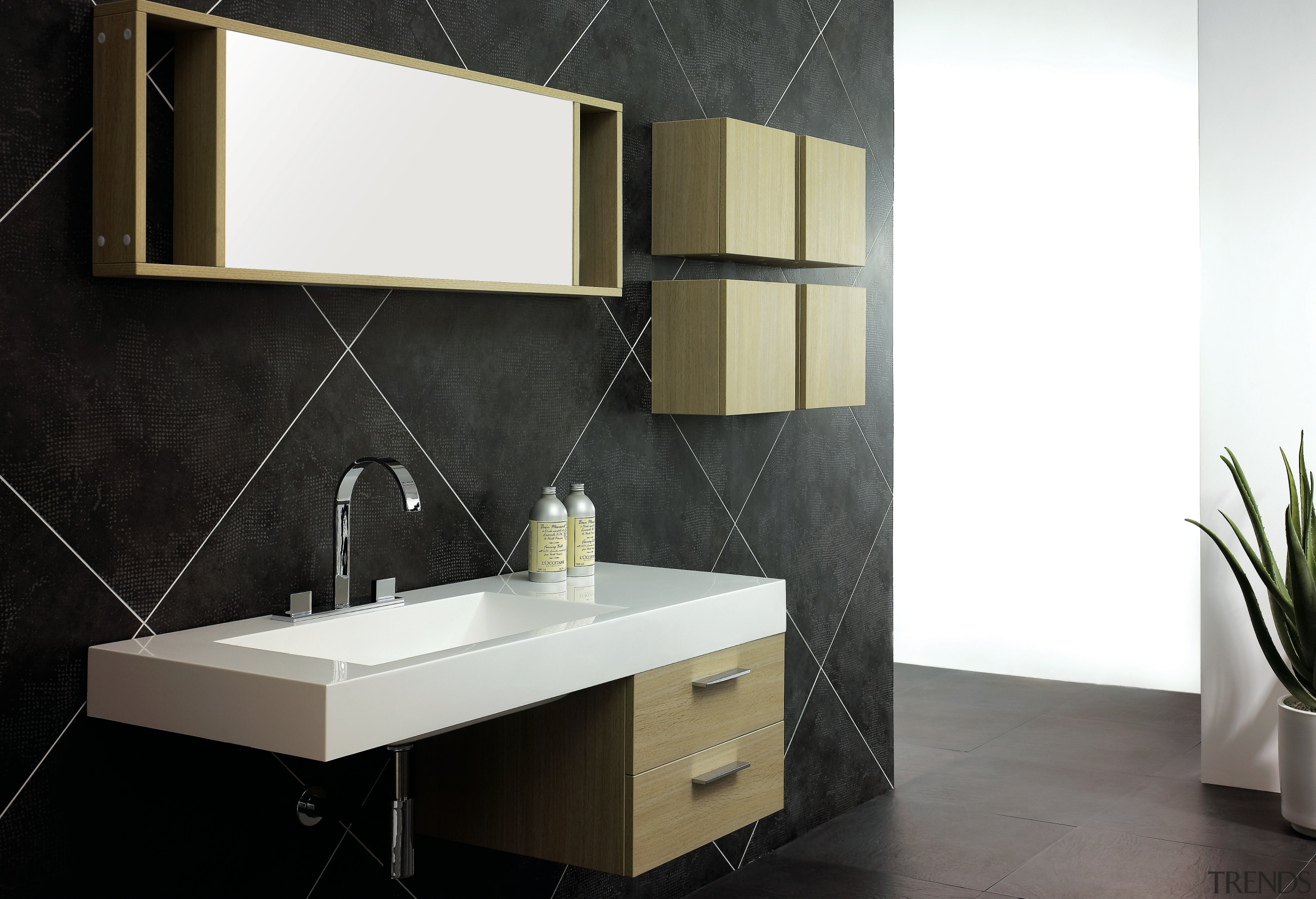 A view of a vanity from Tonusa. - angle, bathroom, bathroom accessory, bathroom cabinet, floor, furniture, interior design, product, product design, sink, tap, tile, wall, black, white