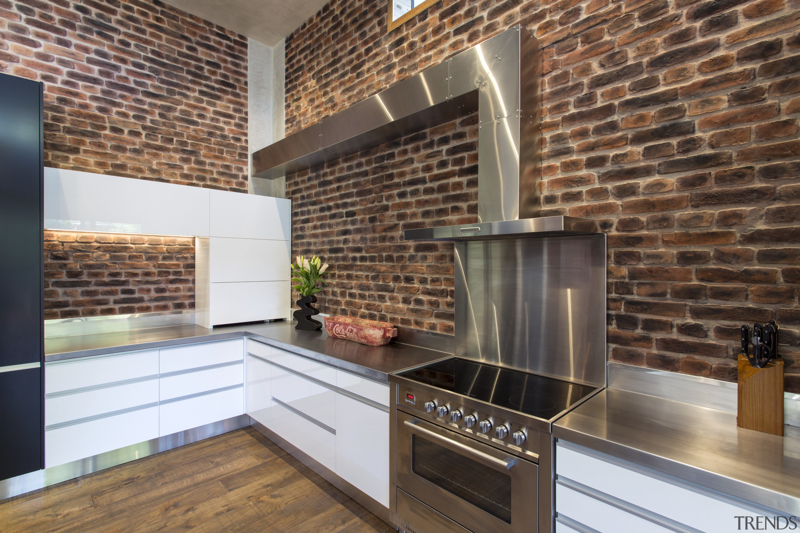L shapes are a design feature of this brick, countertop, fireplace, flooring, hearth, interior design, kitchen, real estate, tile, wood flooring, brown