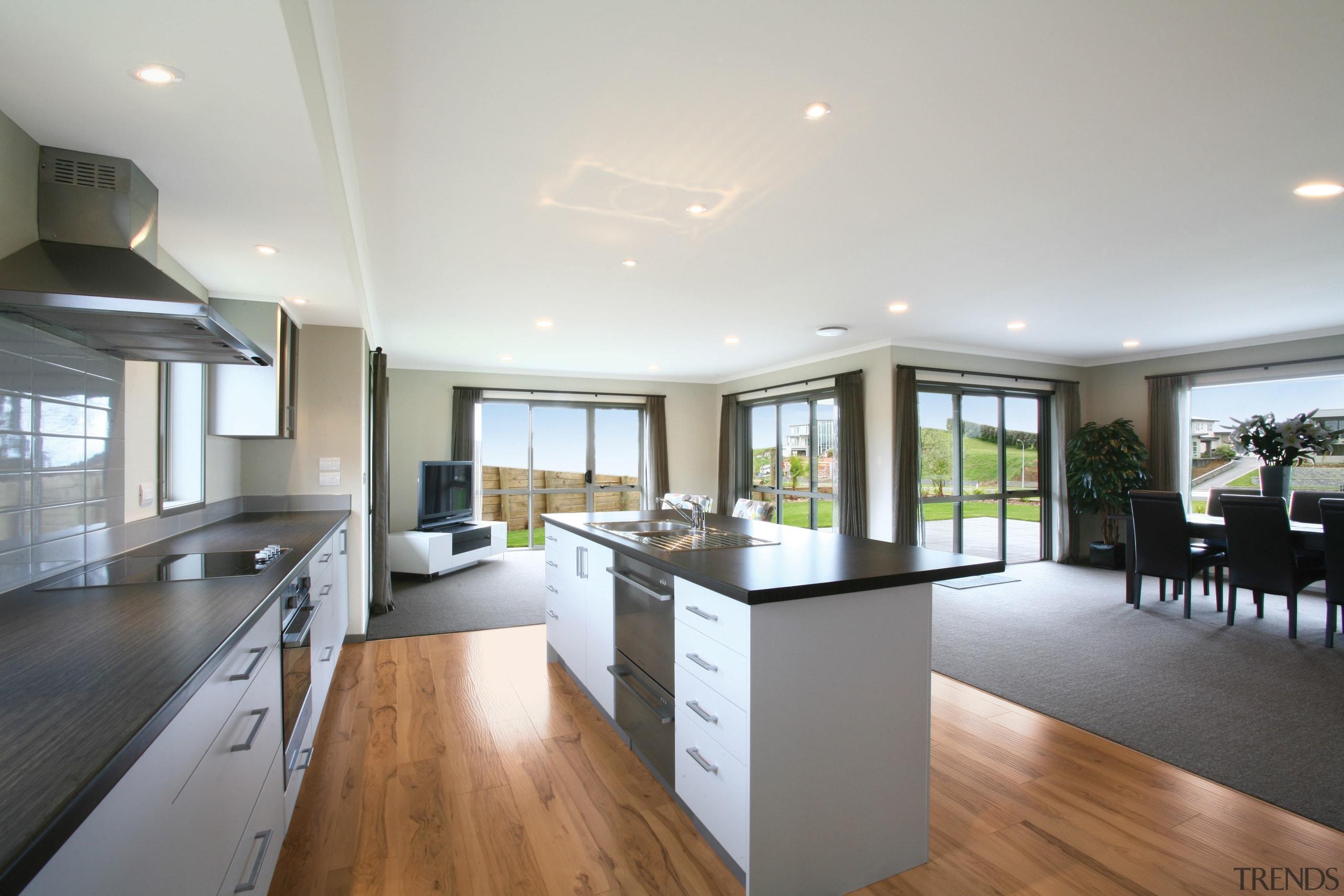View of open-plan kitchen and dining area of countertop, floor, flooring, hardwood, interior design, kitchen, property, real estate, room, window, wood flooring, gray