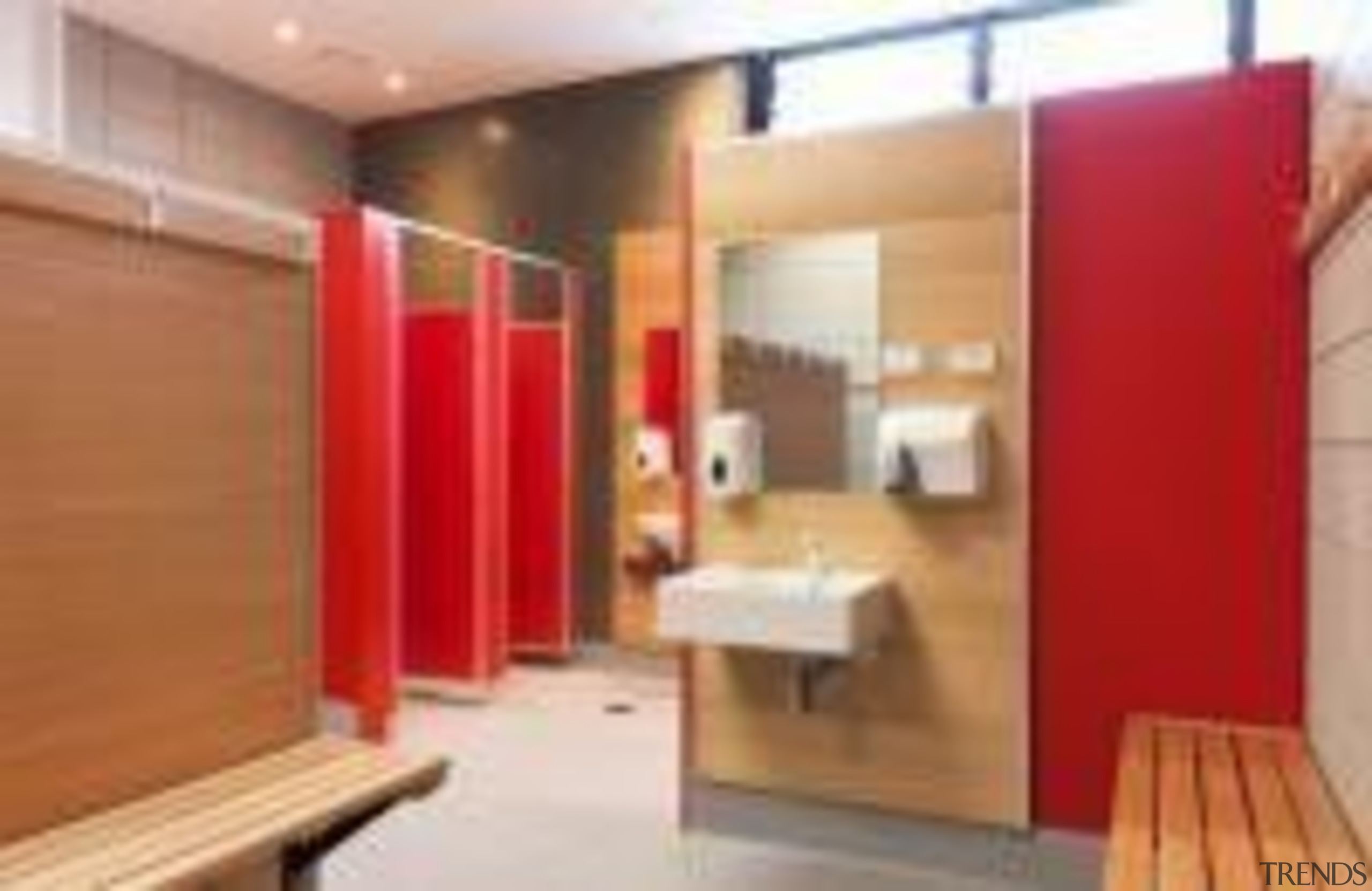 Changing room at St Mary's College Designed by floor, interior design, property, real estate, room, wood, orange, red