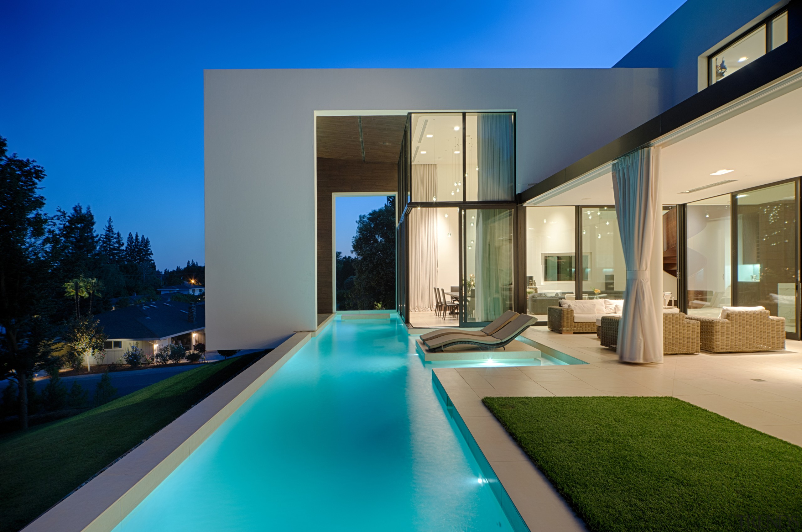 In a warm climate, the boundaries between inside apartment, architecture, condominium, estate, home, house, interior design, lighting, property, real estate, swimming pool, villa
