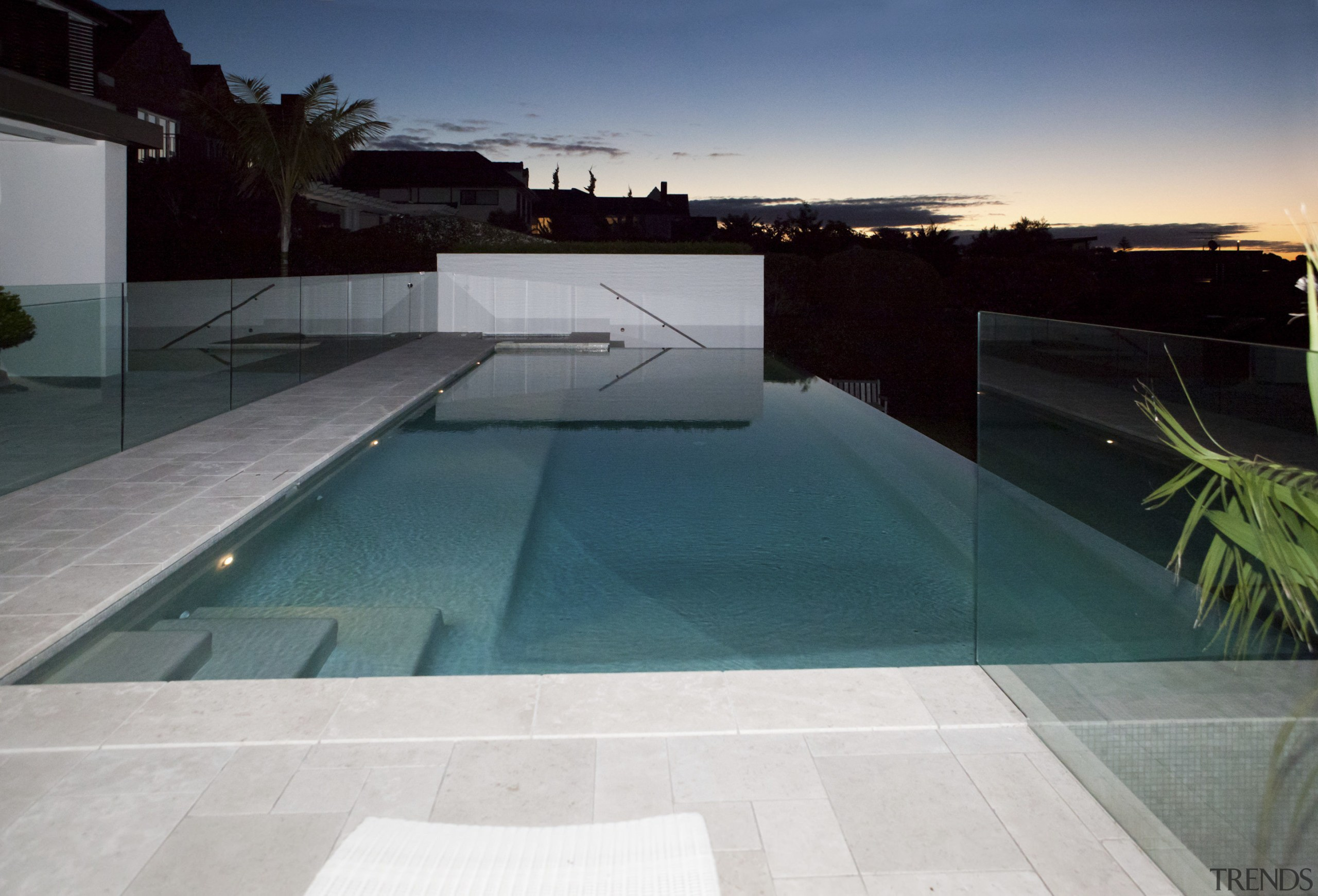 Pool area. - architecture | estate | house architecture, estate, house, leisure, property, real estate, reflection, sky, swimming pool, water