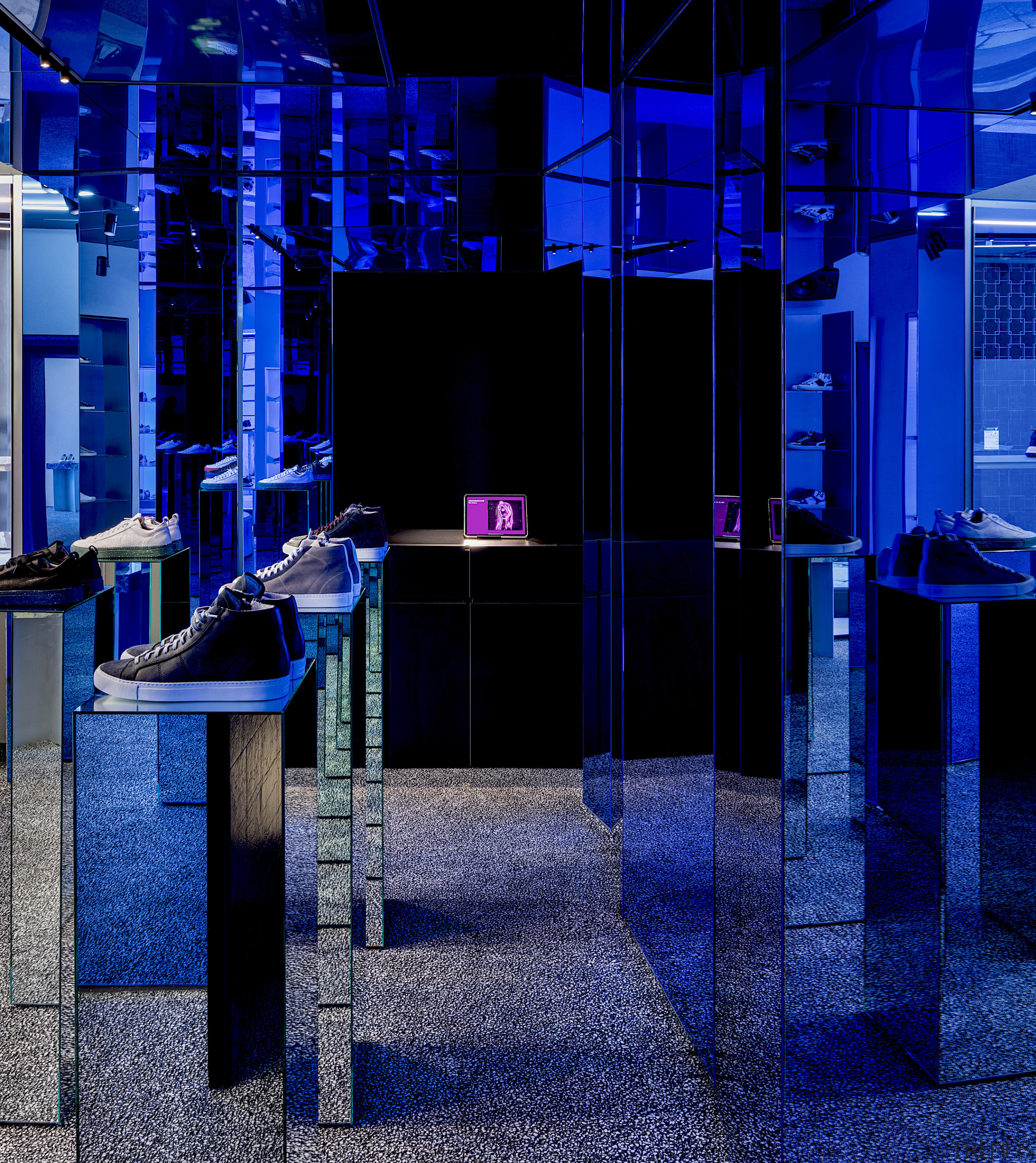 The new P448 shoe store by architects Piuarch blue, black