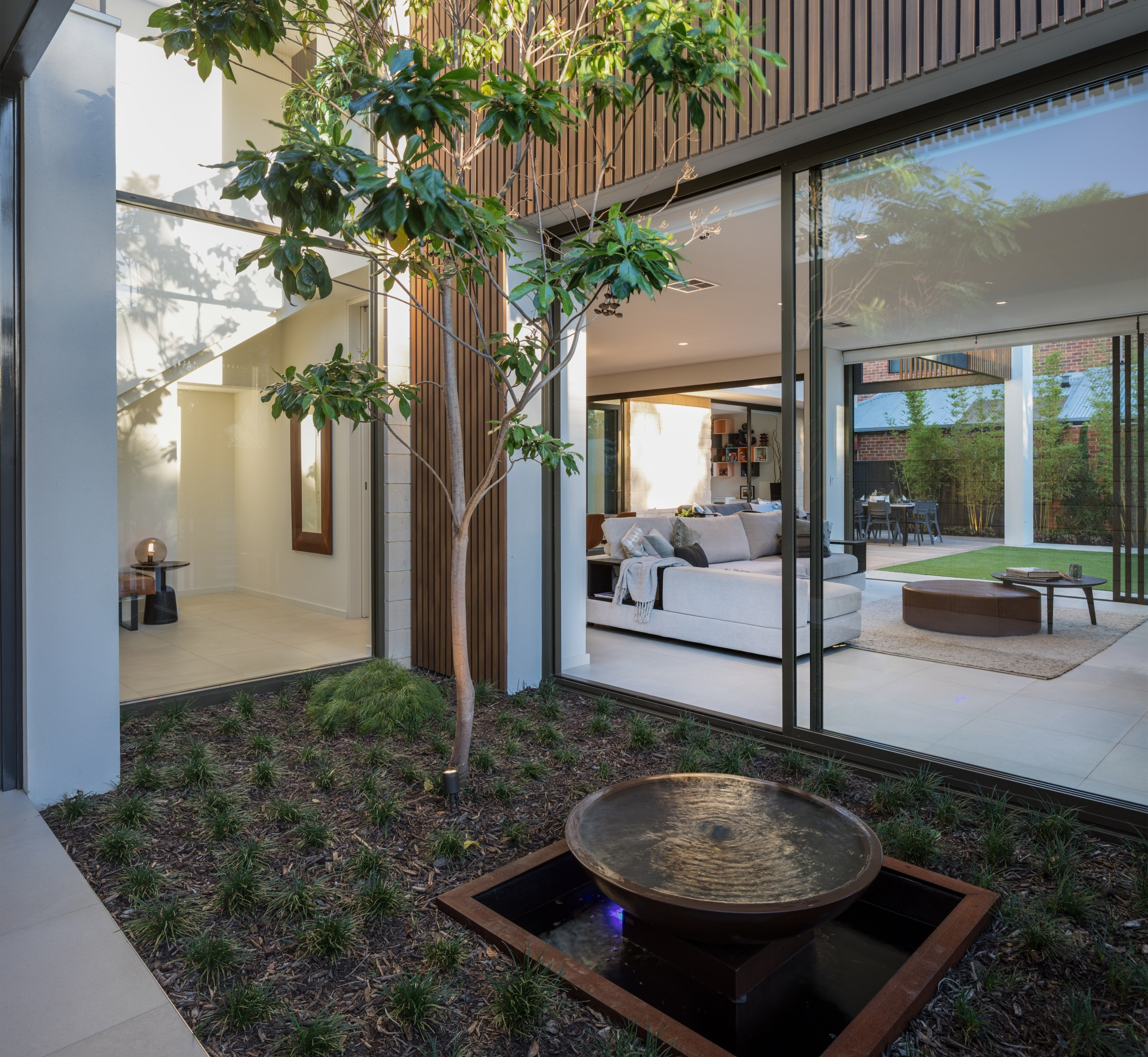 Transparent agenda – approaching the front door, visitors apartment, architecture, backyard, building, courtyard, floor, furniture, home, house, interior design, plant, property, real estate, room, table, tree, gray, black