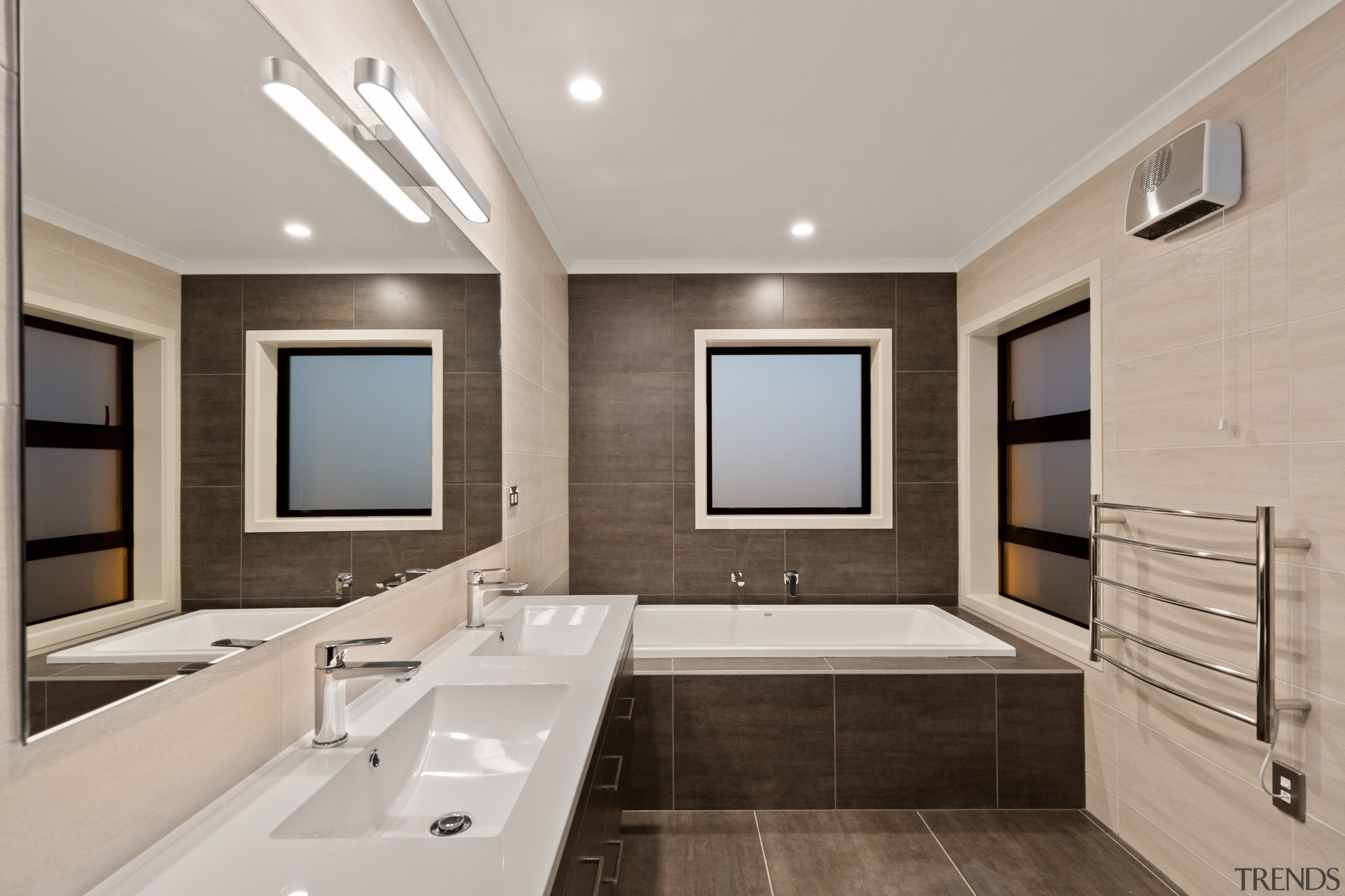 Natural tones and refined surfaces are features of architecture, bathroom, bathtub, building, ceiling, floor, furniture, home, house, interior design, plumbing fixture, property, real estate, room, sink, tap, tile, gray