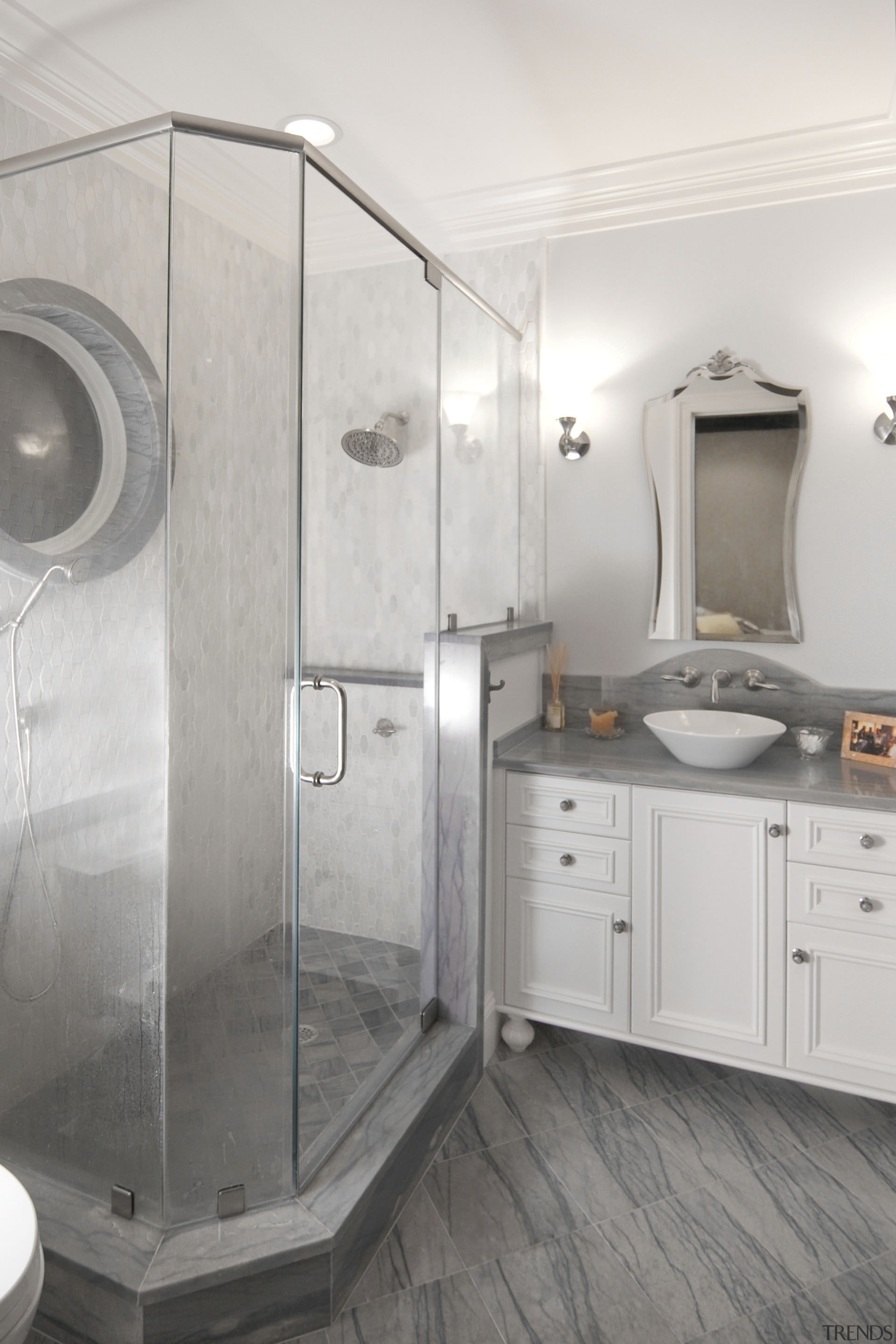 This bathroom by Cheryl Kees Clendenon manipulates color, bathroom, interior design, plumbing fixture, room, white, gray