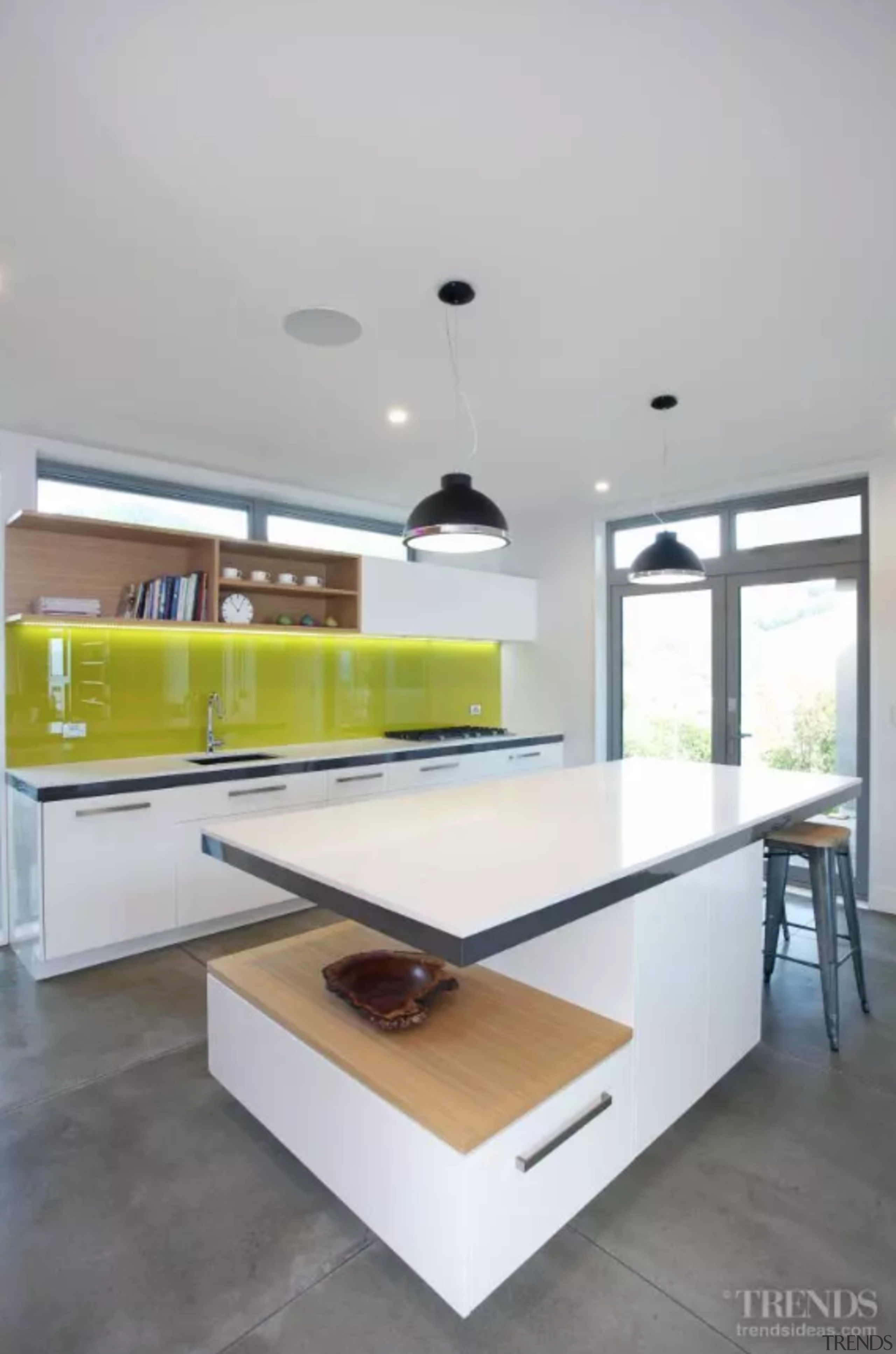 A backpainted glass splashback provides a vibrant accent. architecture, building, cabinetry, ceiling, countertop, design, floor, furniture, house, interior design, kitchen, material property, property, room, shelf, table, gray