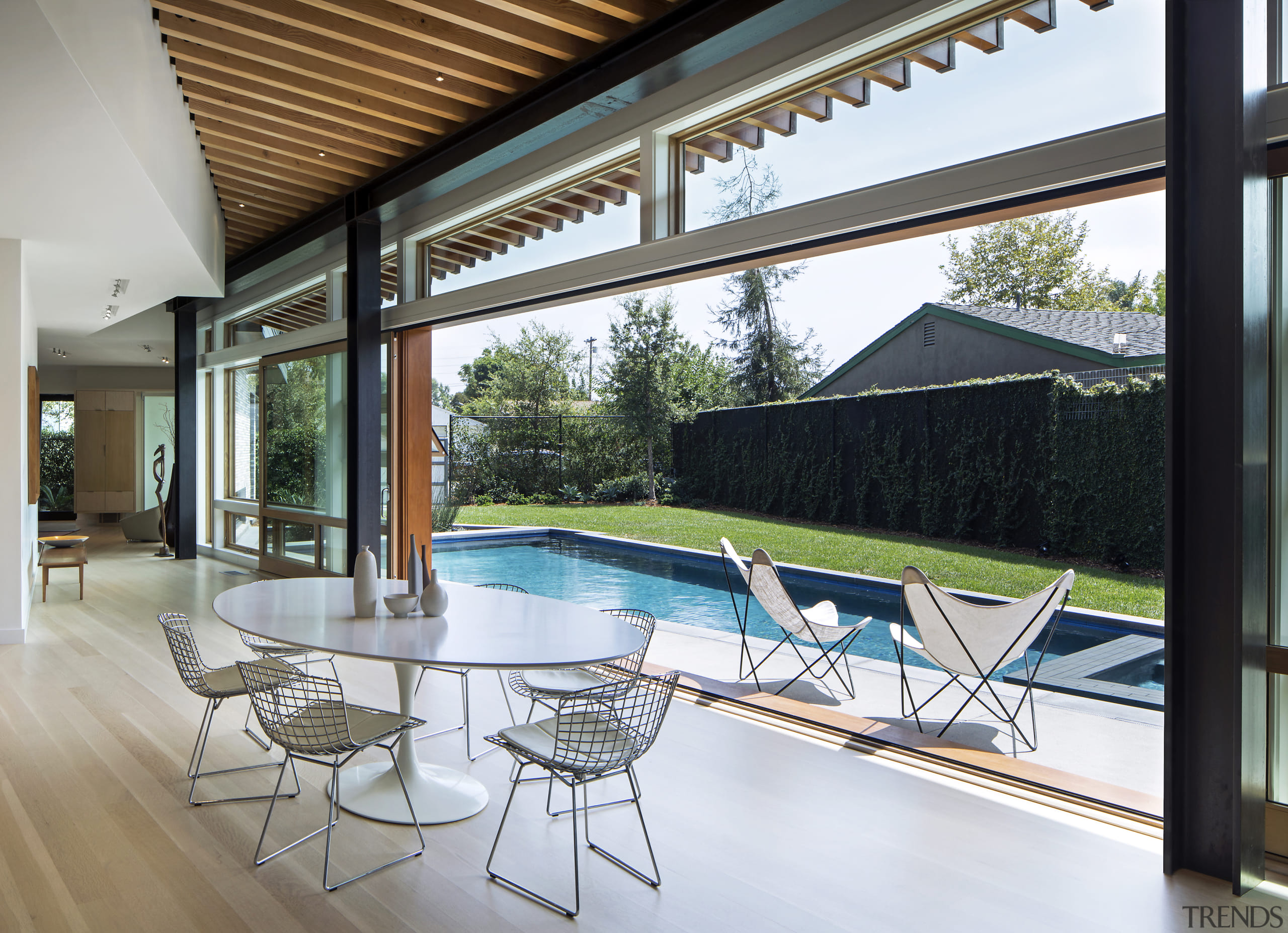 Sliding glass doors open up the dining area architecture, courtyard, furniture, home, house, interior design, shade, swimming pool, Nils Finne, Finne Architects