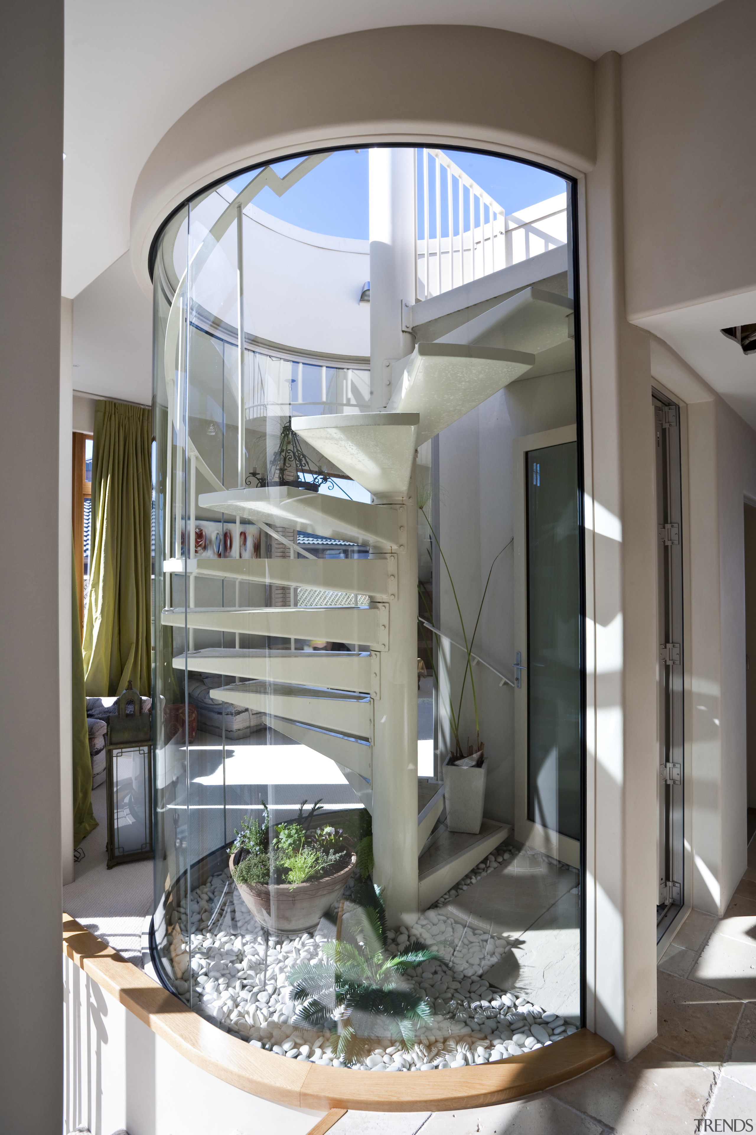 View of the spiral staircase that leads to glass, interior design, stairs, gray, white