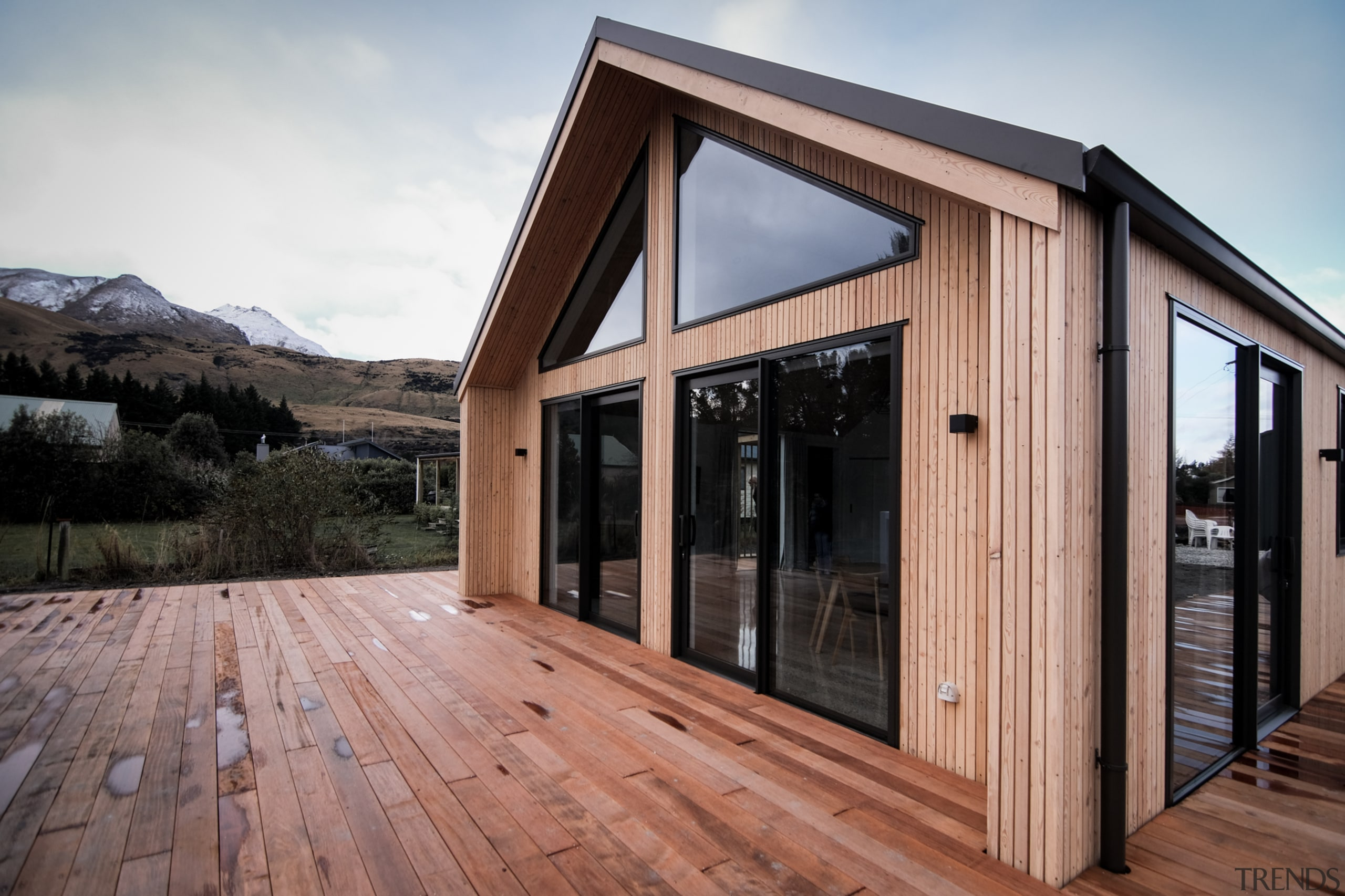 Exotic wood cladding and decking give this Fowler