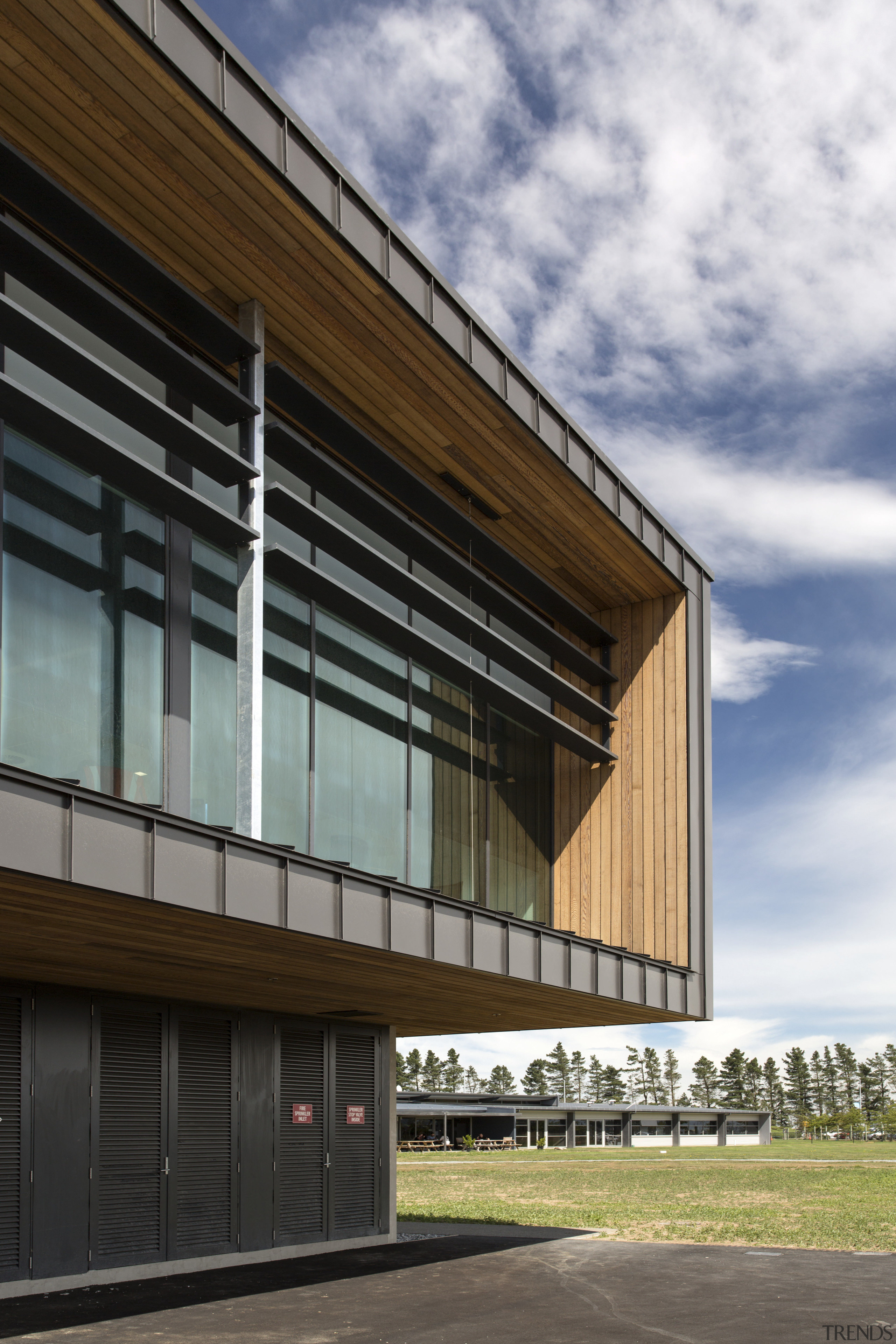 Wood soffits add a natural accent to the architecture, building, commercial building, corporate headquarters, facade, headquarters, house, sky, structure, window, gray, black