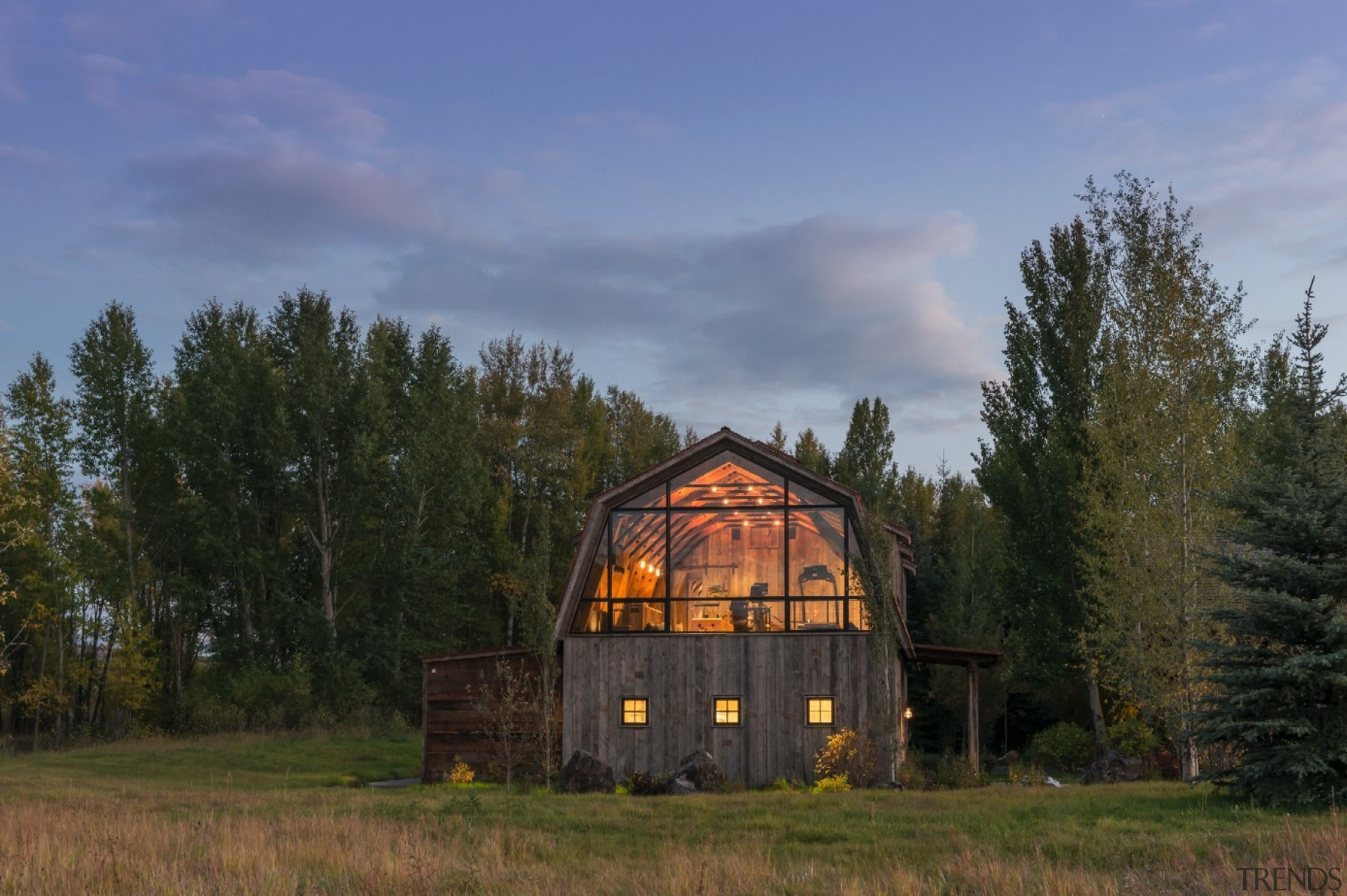 It's still clear you're looking at a barn barn, cloud, cottage, farm, farmhouse, field, grass, home, house, hut, landscape, log cabin, meadow, prairie, property, real estate, rural area, shack, sky, tree, brown, blue