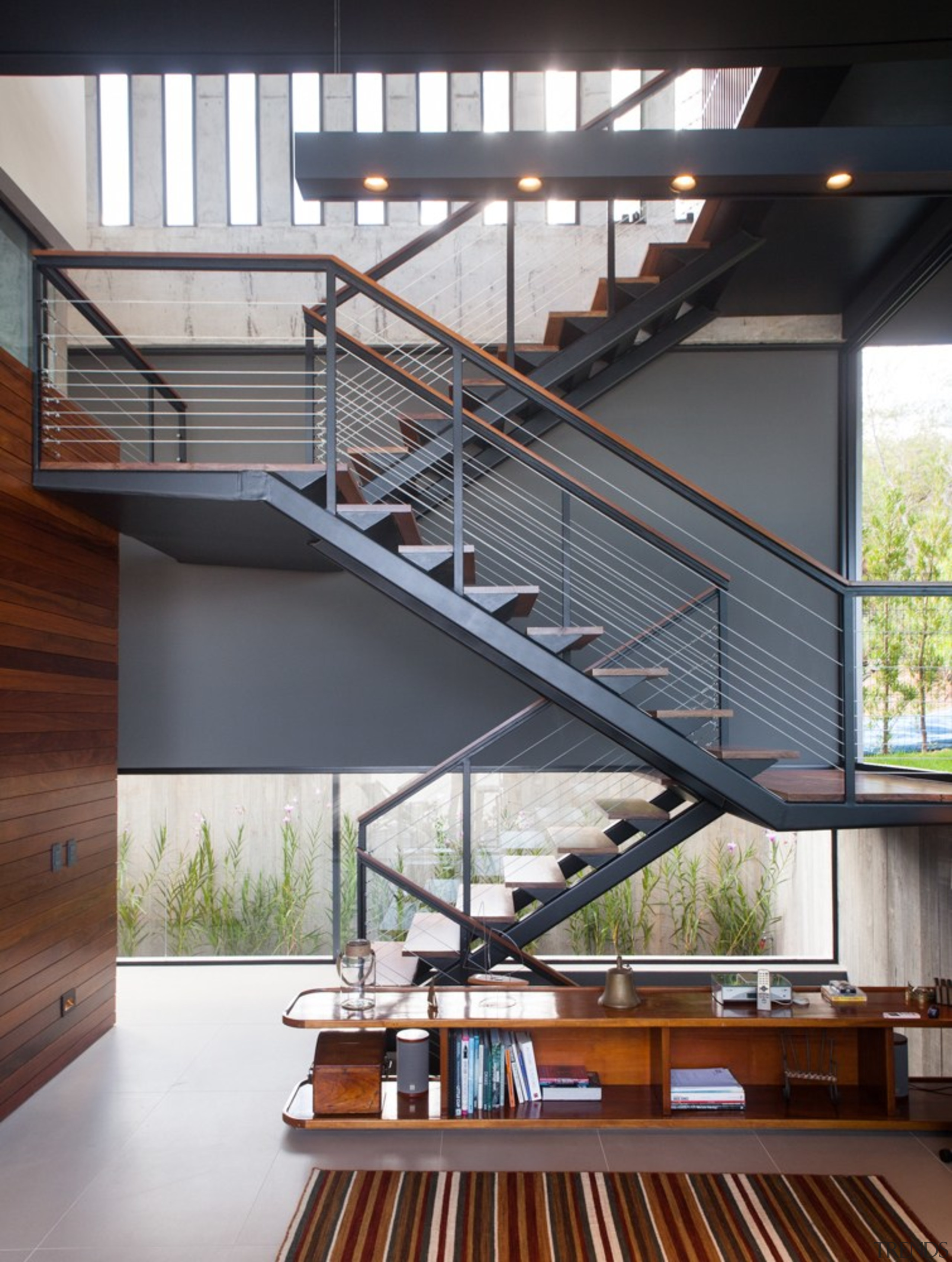 The staircase zig-zags its way up - architecture architecture, daylighting, handrail, house, stairs, gray, white