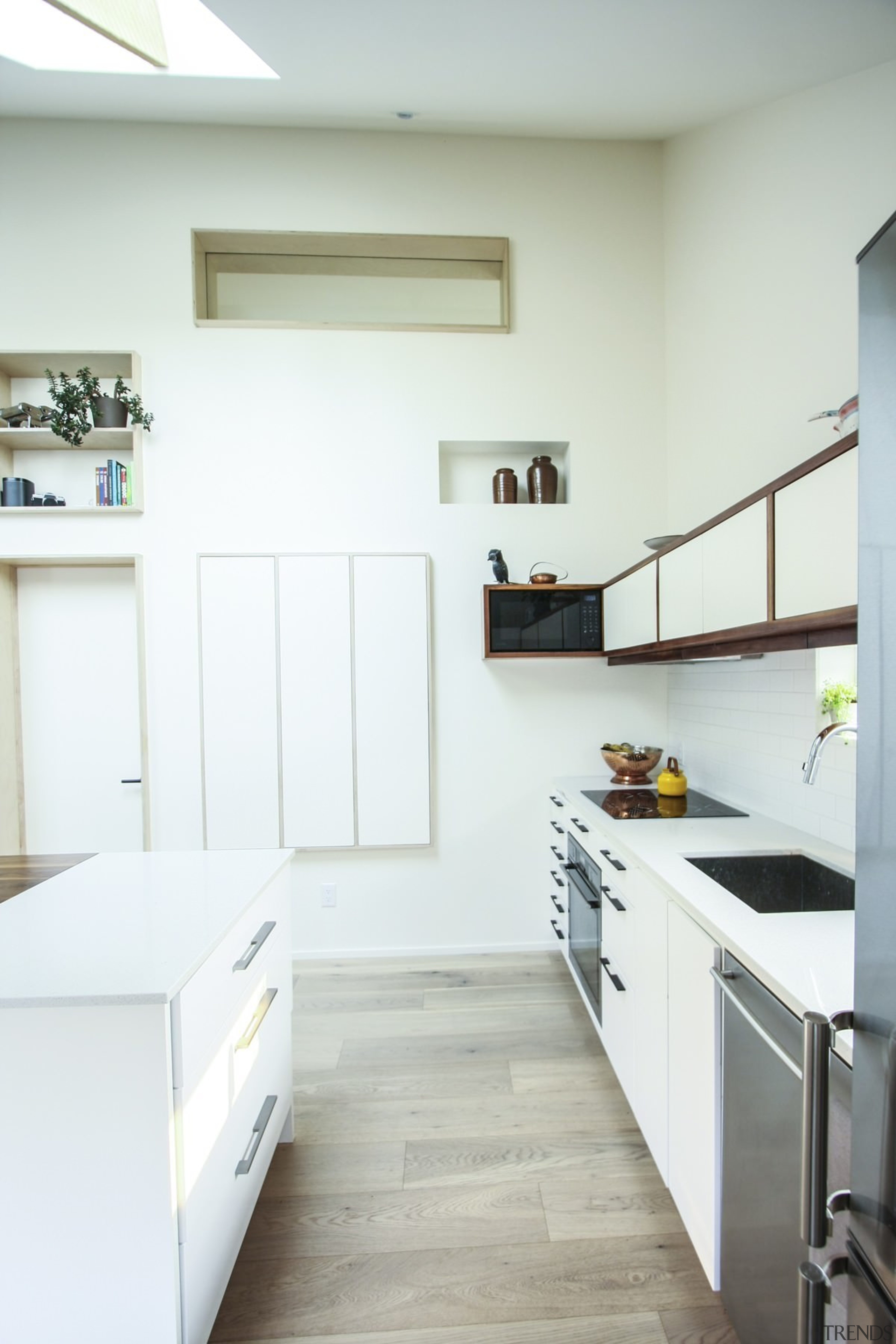 Clever storage spaces line the living area - countertop, daylighting, floor, home, house, interior design, kitchen, room, white, gray