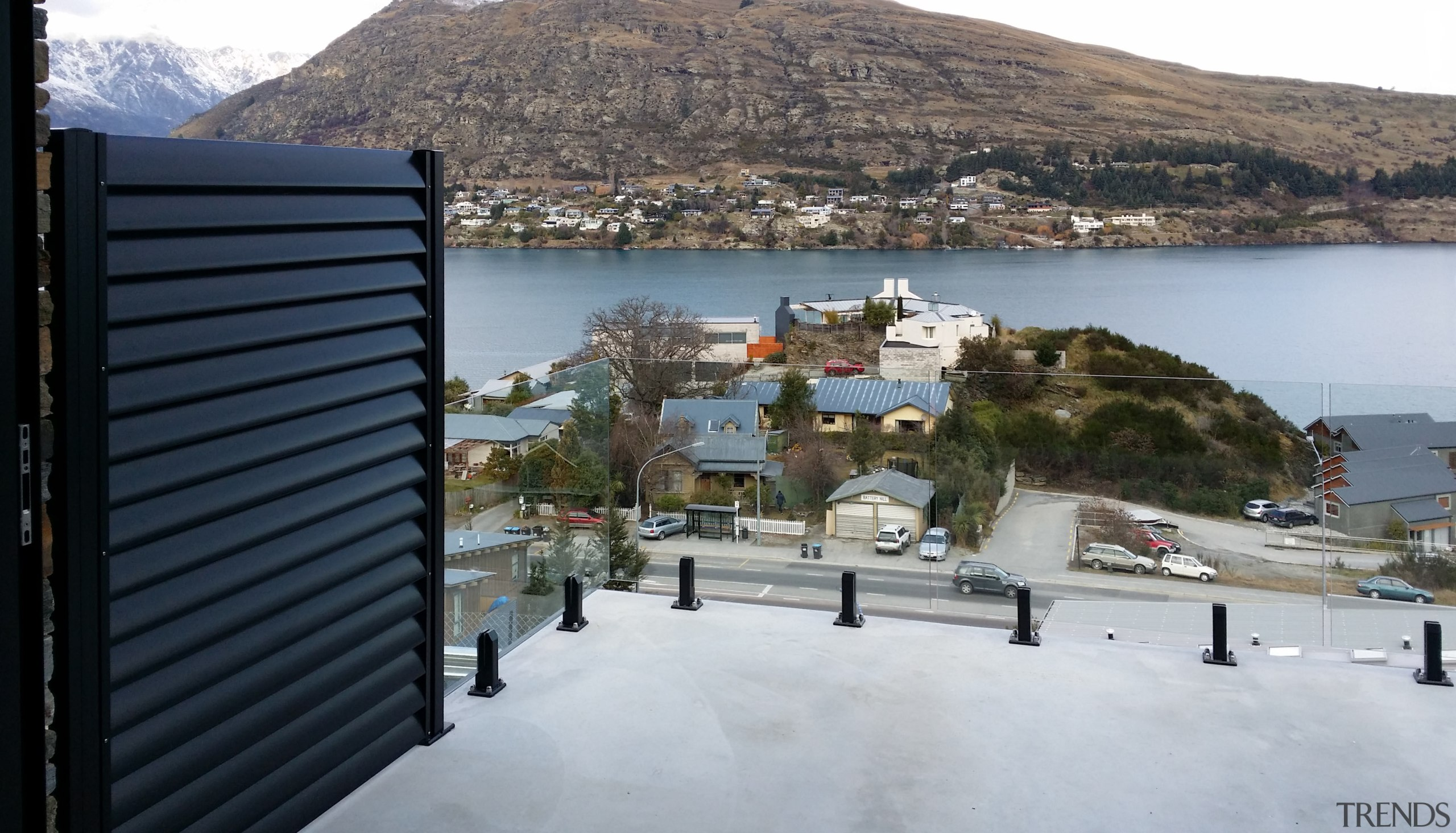 Privacy screens  between decks on this projectwere property, real estate, roof, sea, sky, town, gray, black