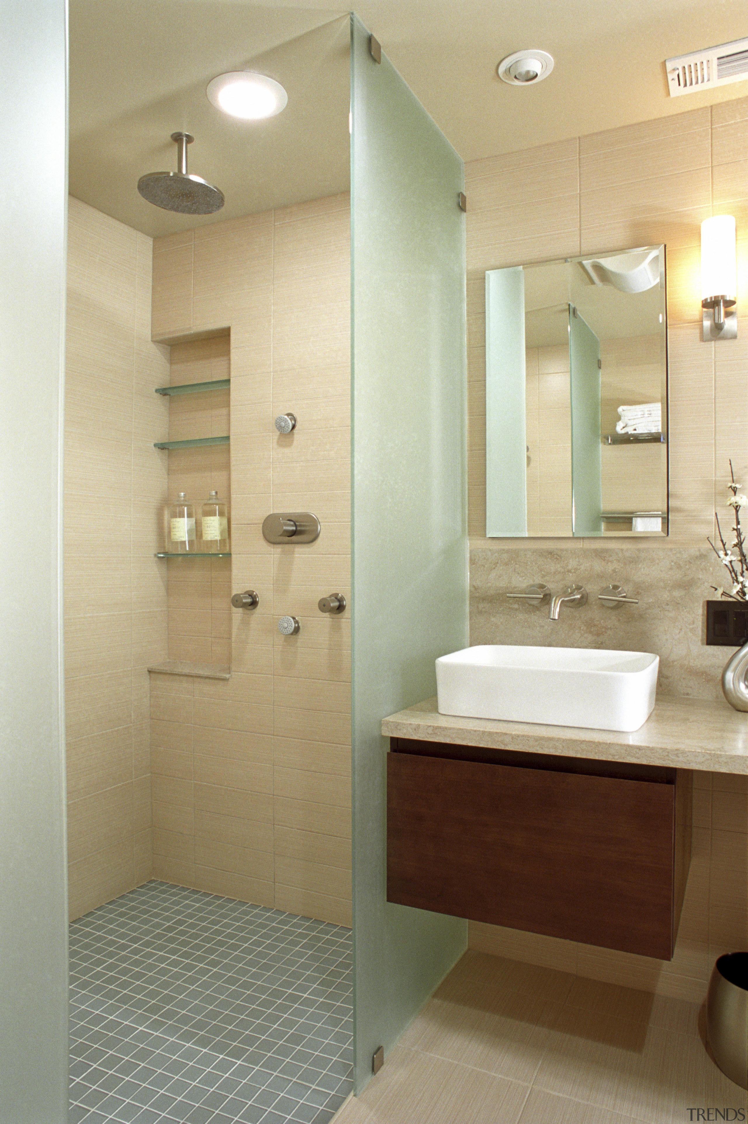 A view of some bathroom ware from NKBA. bathroom, bathroom accessory, bathroom cabinet, floor, home, interior design, plumbing fixture, room, sink, orange