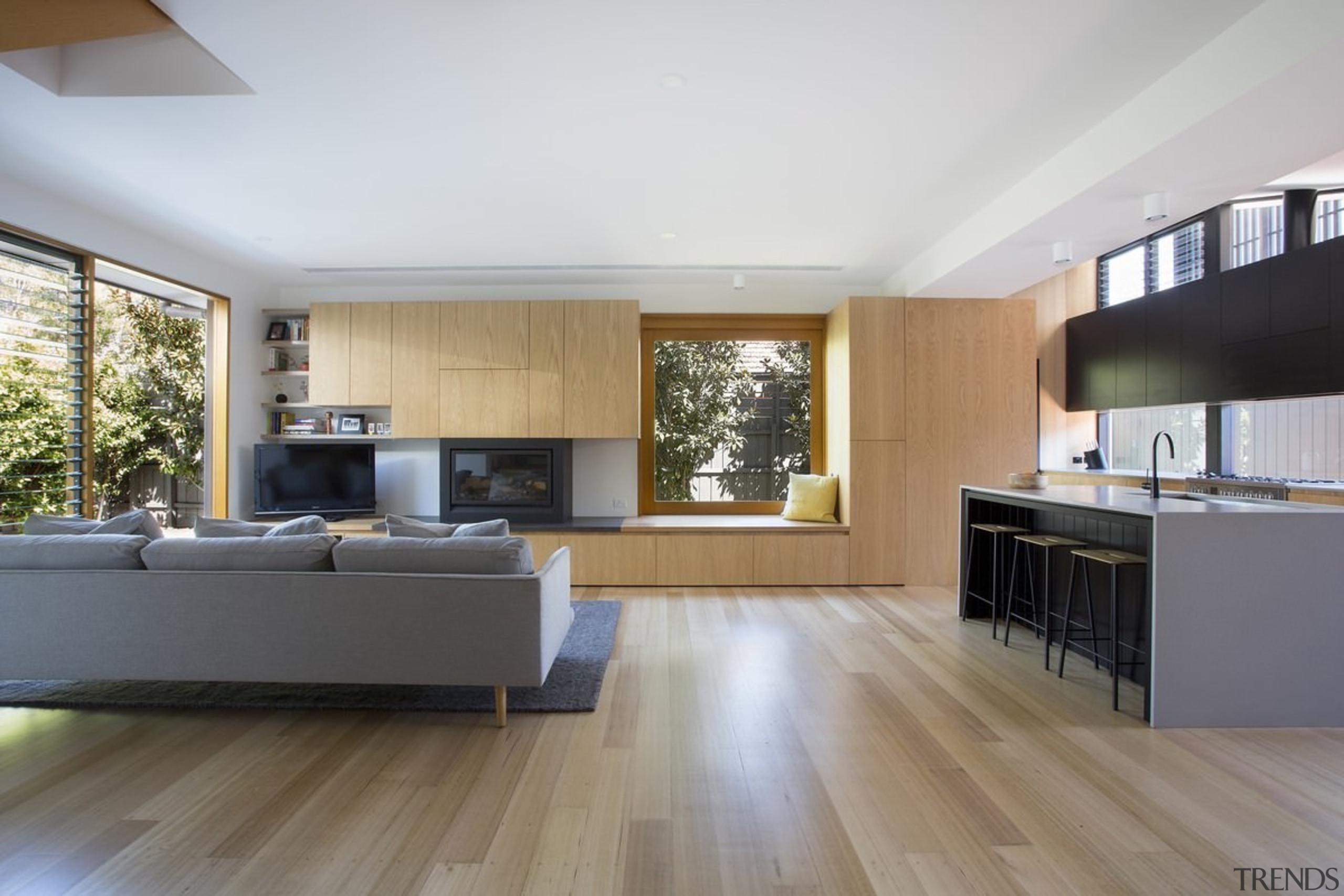It's an ideal home for entertaining - It's architecture, floor, flooring, hardwood, house, interior design, kitchen, laminate flooring, living room, room, wood, wood flooring, gray