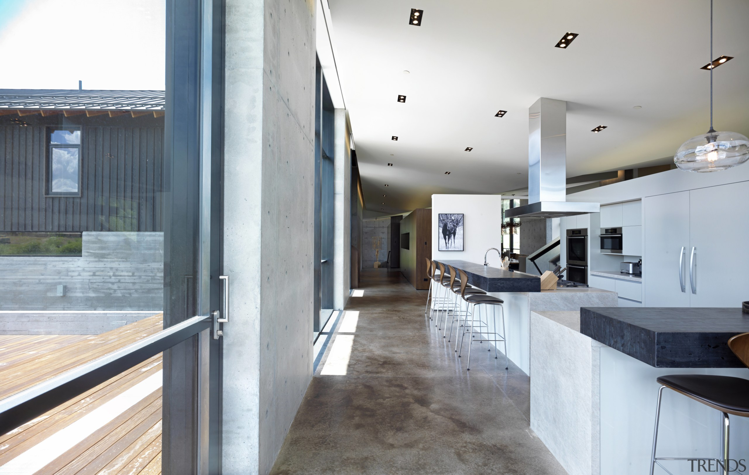 Stained concrete floors and concrete walls feature in architecture, countertop, floor, flooring, house, interior design, real estate, gray