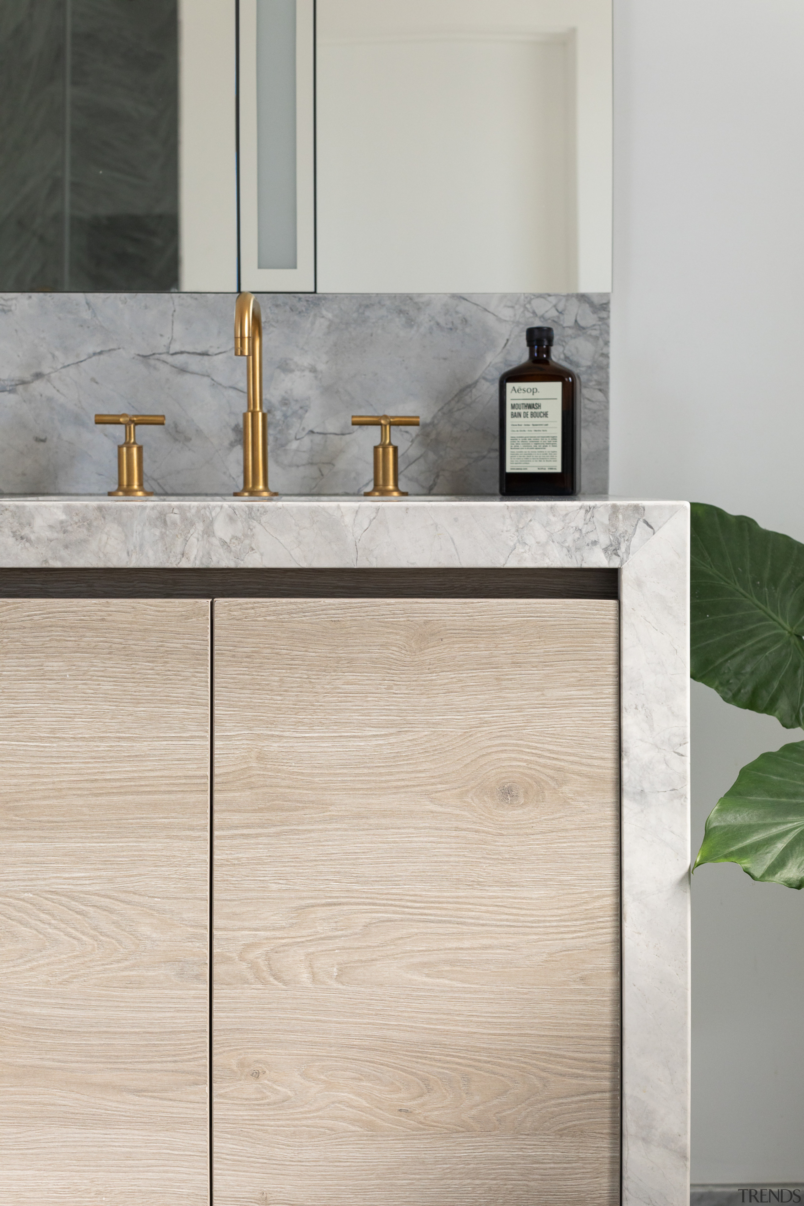 Natural materials in the bathroom are punctuated by