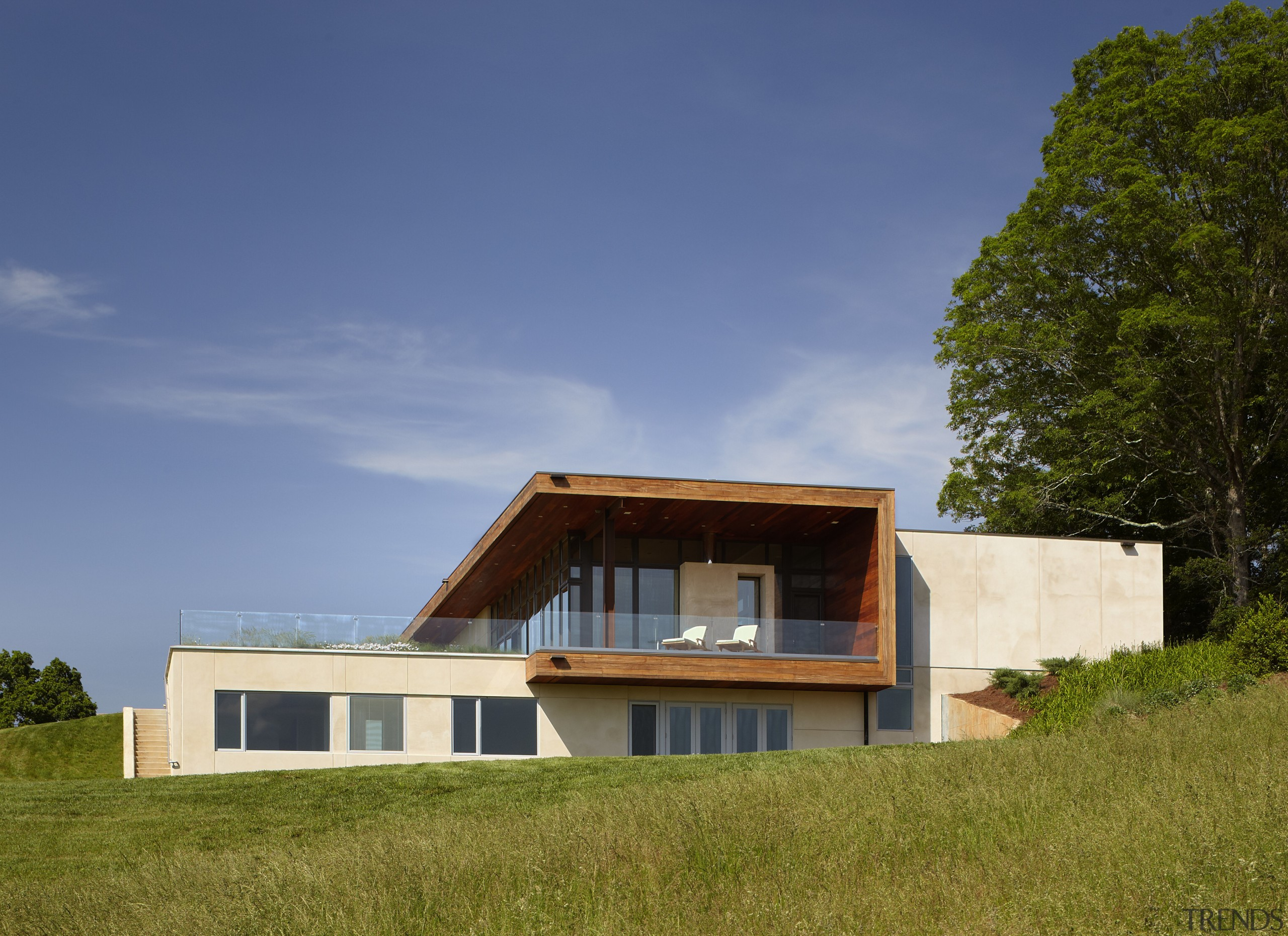Exterior of house with rusted corten steel. Sustainable architecture, cottage, elevation, estate, facade, farmhouse, home, house, property, real estate, sky, villa, brown, blue