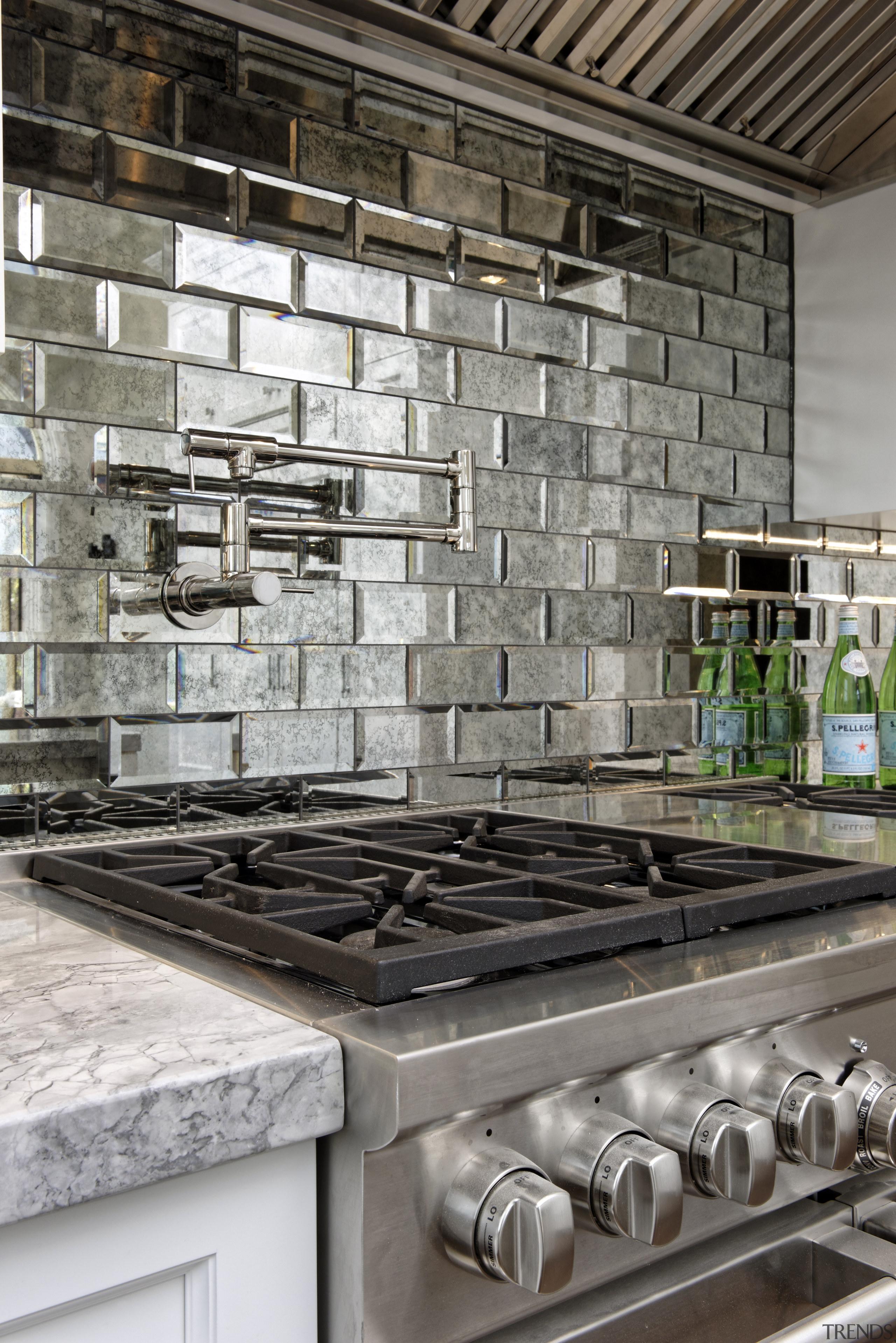 Hefty appliances meet chunky countertops in this upmarket countertop, interior design, tile, wall, gray, black