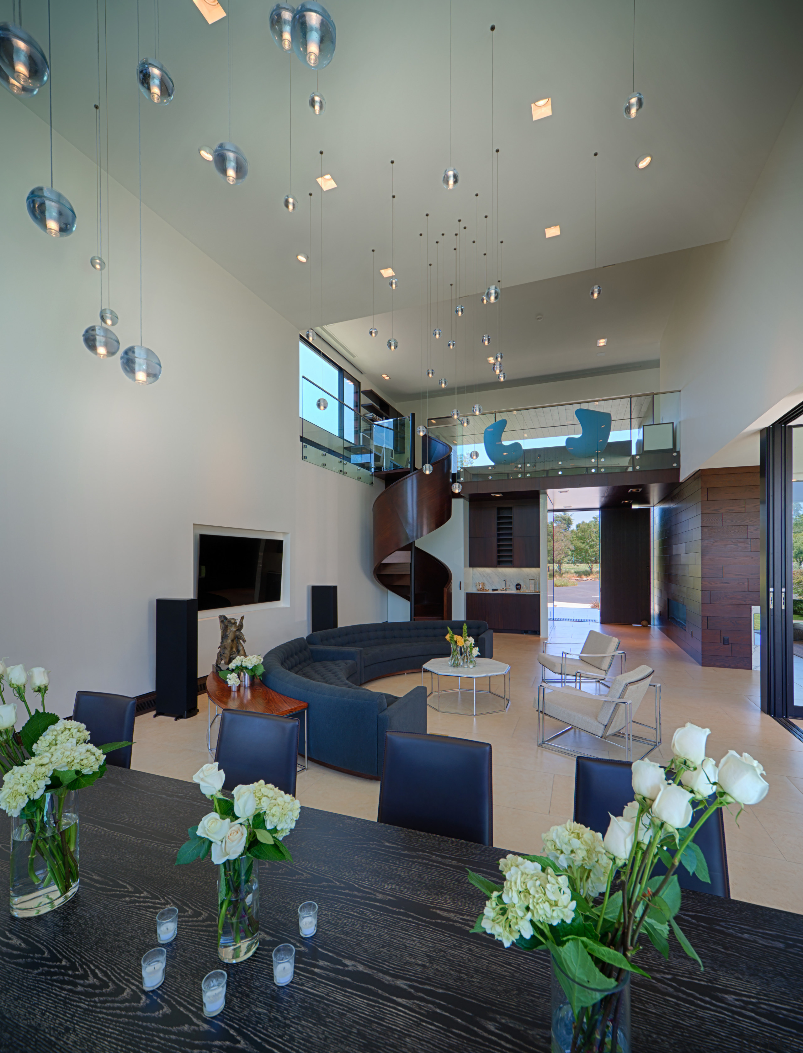 A spiral staircase near the entry leads up ceiling, interior design, living room, lobby, gray