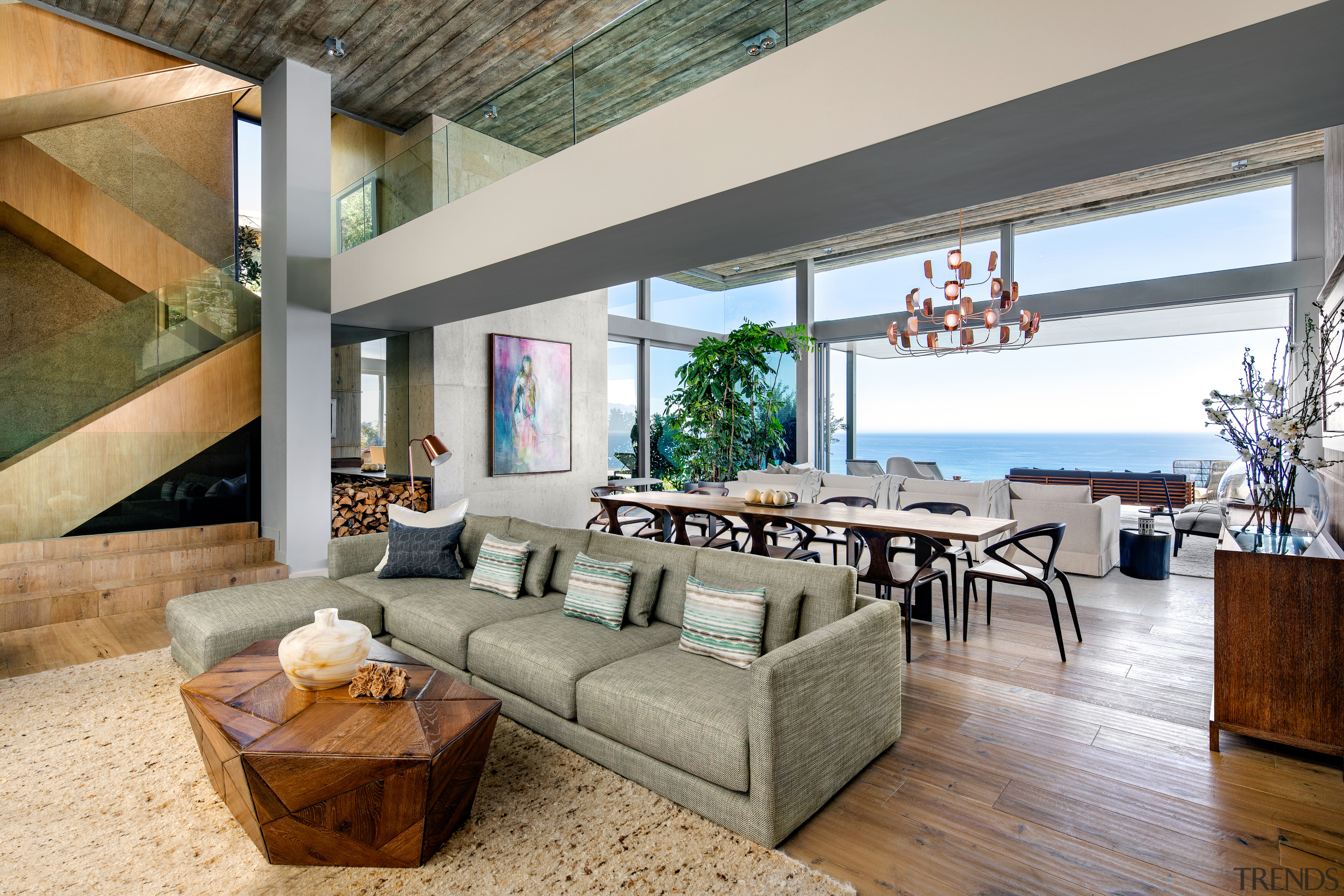 The living level is set back considerably to apartment, architecture, building, ceiling, coffee table, couch, estate, floor, flooring, furniture, hardwood, home, house, interior design, laminate flooring, living room, loft, property, real estate, roof, room, table, wall, wood, wood flooring, gray