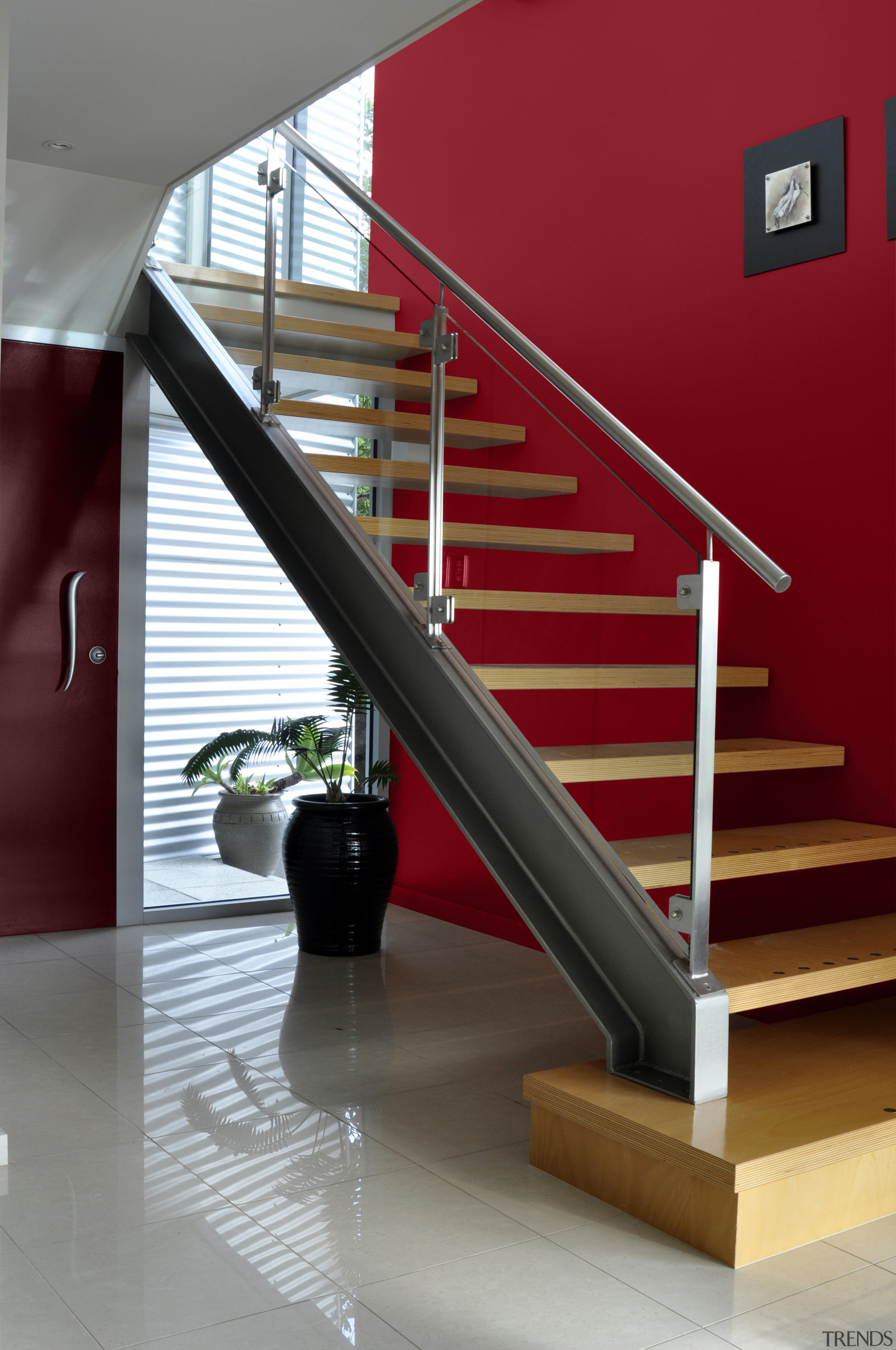 View of different coloured feature walls behind a architecture, baluster, floor, handrail, interior design, product design, stairs, structure, red