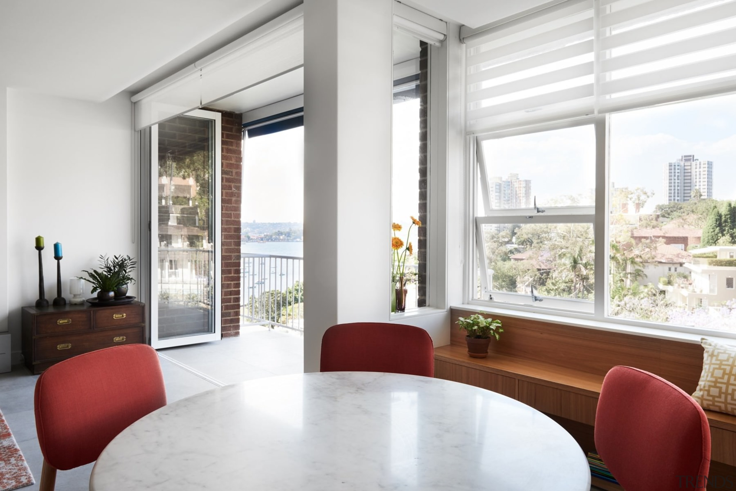 The living room has views out to the apartment, daylighting, house, interior design, living room, property, real estate, window, window covering, window treatment, white