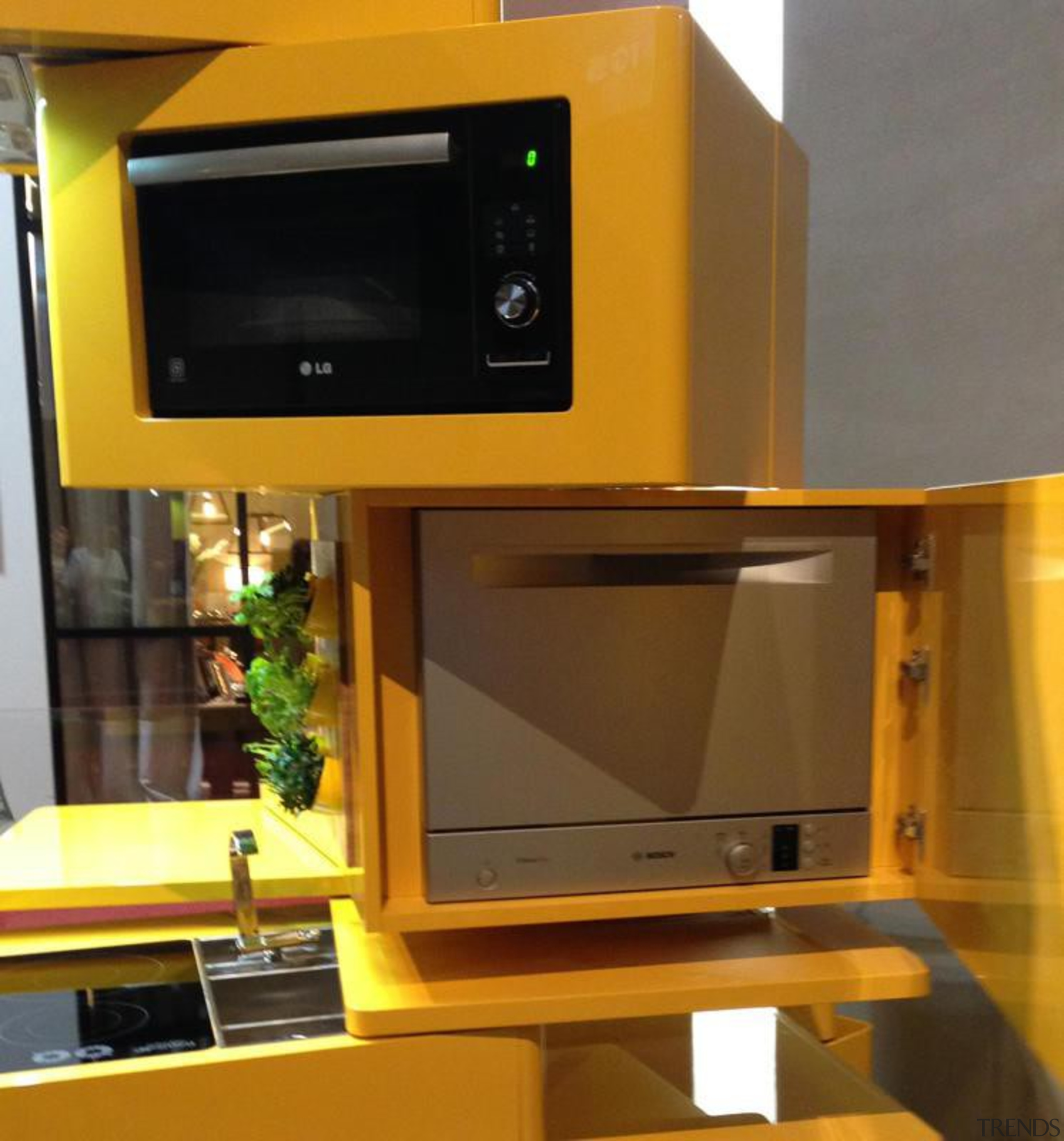 Forget 'bigger is better'; in the eco-conscious yet display device, electronic device, electronics, furniture, home appliance, technology, yellow, brown