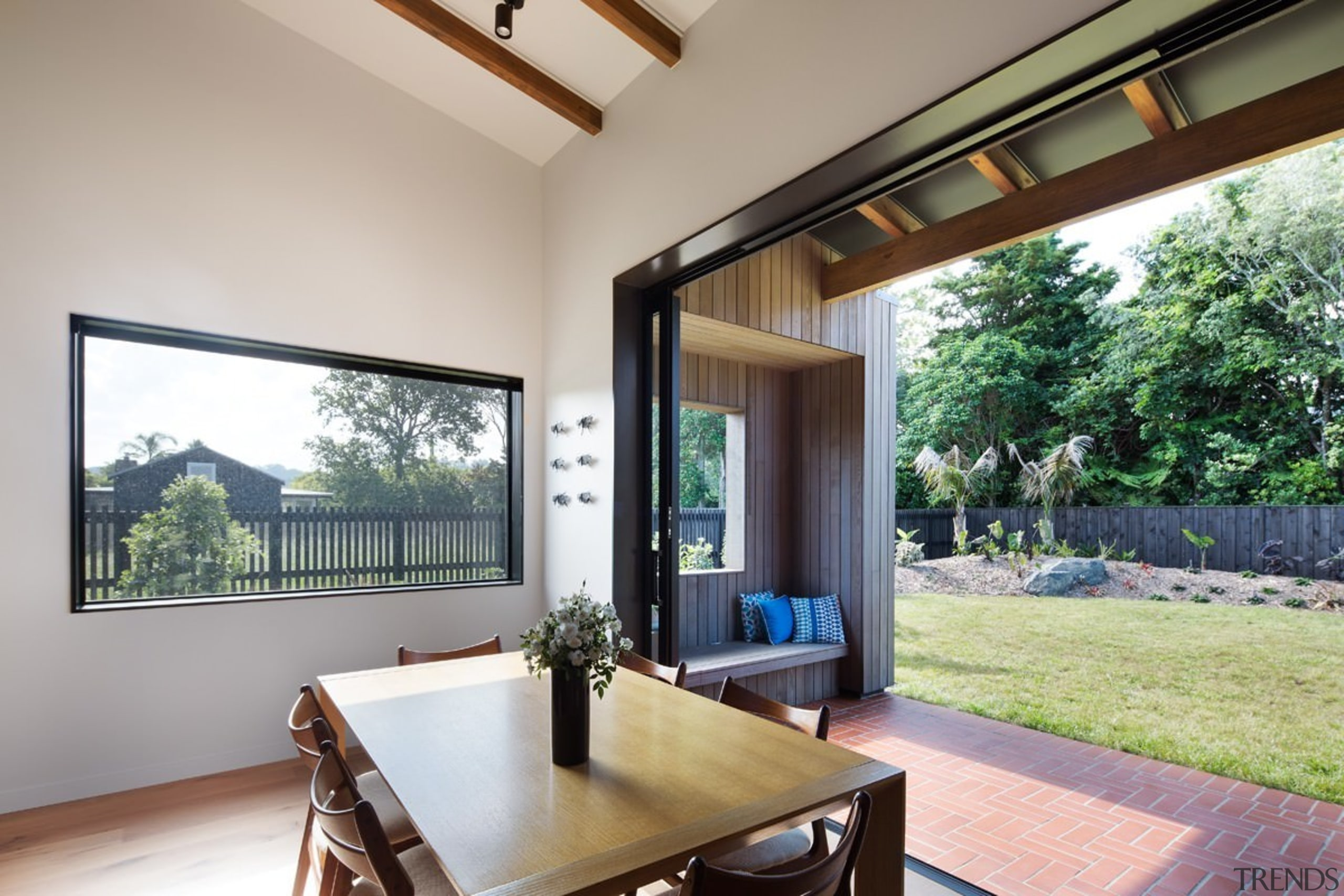 The dining area opens up to the back estate, house, interior design, property, real estate, window, gray
